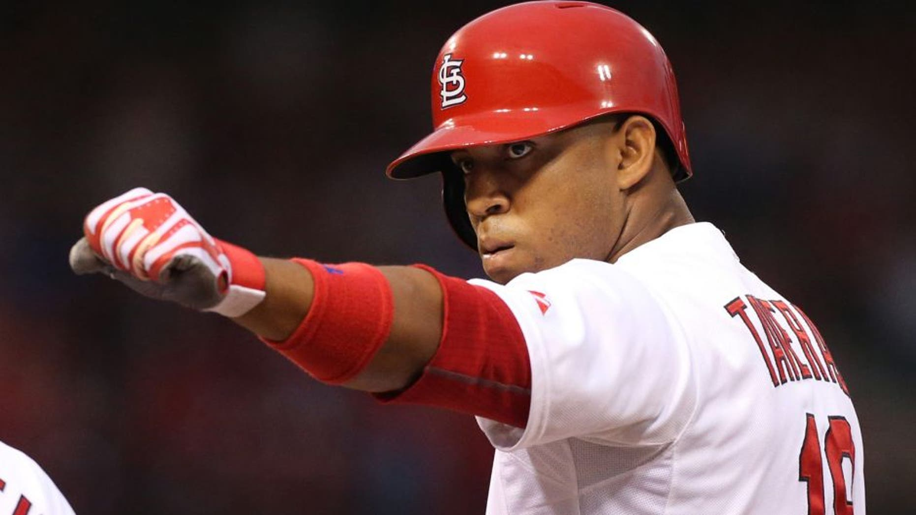 St. Louis Cardinals' Oscar Taveras gestures to teammates in the dugout after driving in a run with a single in first inning action during a baseball game between the St. Louis Cardinals and the Boston Red Sox on Thursday, Aug. 7, 2014, at Busch Stadium in St. Louis. (AP Photo/St. Louis Post-Dispatch, Chris Lee) EDWARDSVILLE INTELLIGENCER OUT; THE ALTON TELEGRAPH OUT