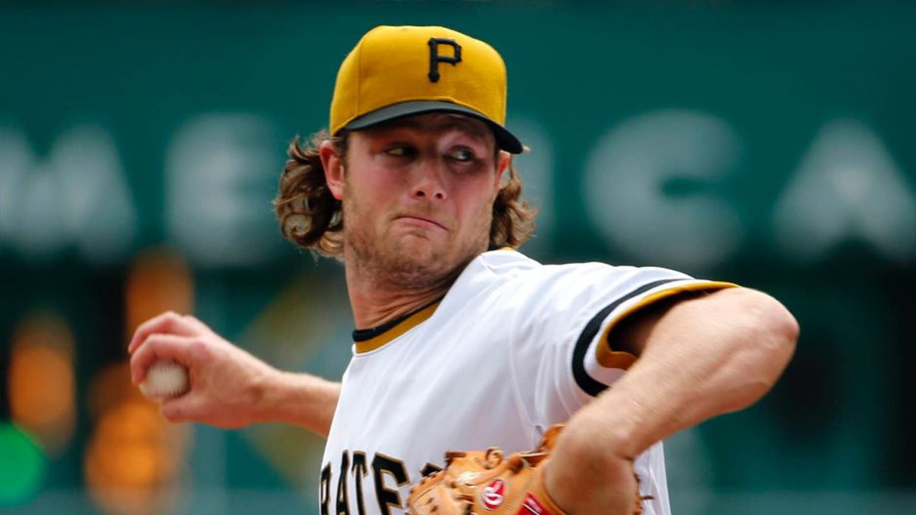 Pittsburgh Pirates starting pitcher Gerrit Cole throws in the first inning against the Milwaukee Brewers in Pittsburgh, Sunday, April 19, 2015.