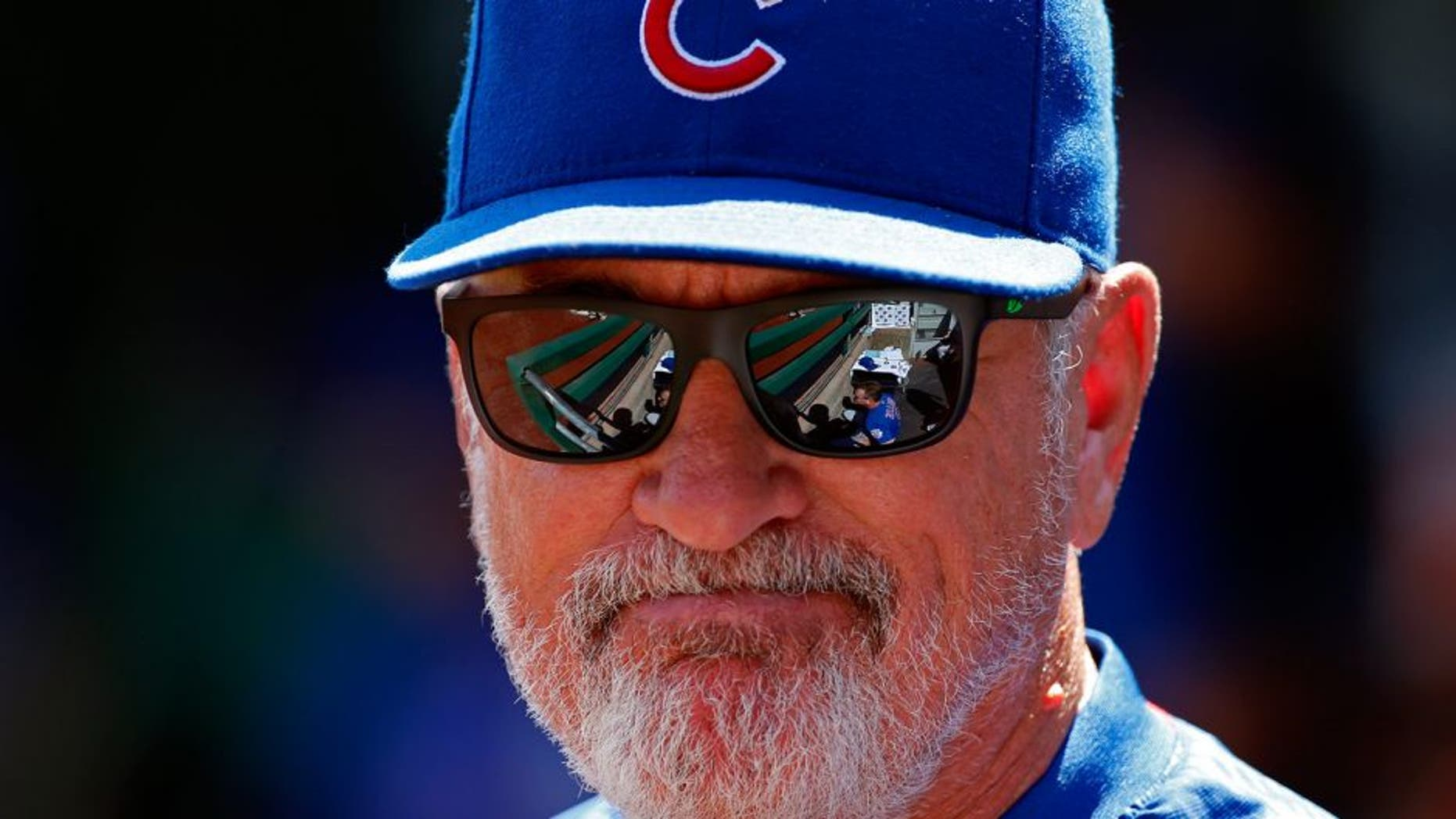 Chicago Cubs manager Joe Maddon stands in the dugout during the first baseball game of a doubleheader in Pittsburgh against the Pittsburgh Pirates, Tuesday, Sept. 15, 2015. (AP Photo/Gene J. Puskar)