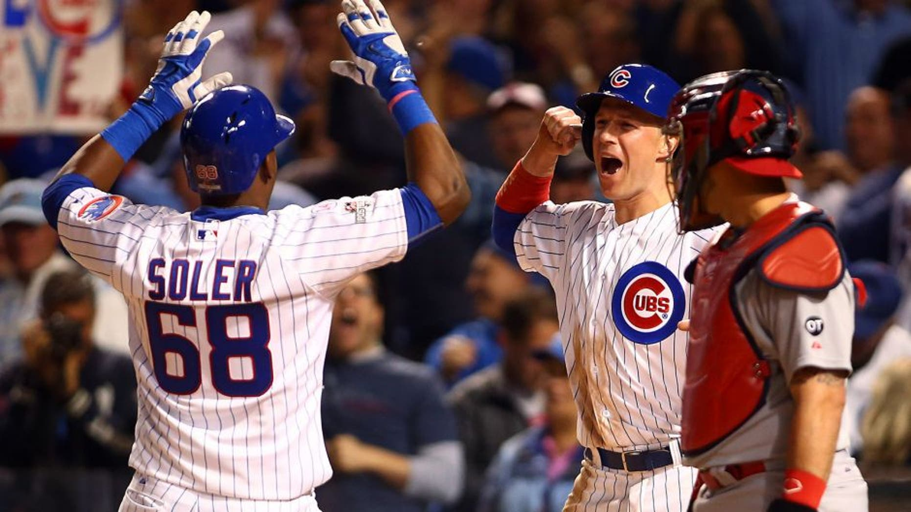 Oct 12, 2015; Chicago, IL, USA; Chicago Cubs right fielder Jorge Soler (68) celebrates with left fielder Chris Coghlan (8) after hitting a two run home run during the sixth inning against the St. Louis Cardinals in game three of the NLDS at Wrigley Field. Mandatory Credit: Jerry Lai-USA TODAY Sports