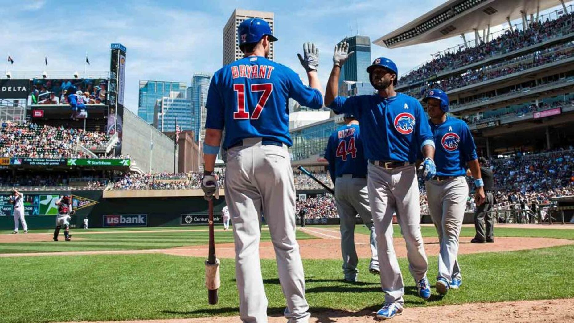 Jun 21, 2015; Minneapolis, MN, USA; Chicago Cubs center fielder Dexter Fowler (24) is congratulated by third baseman Kris Bryant (17) after hitting a grand slam home run during the eighth inning against the Minnesota Twins at Target Field. The Cubs won 8-0.