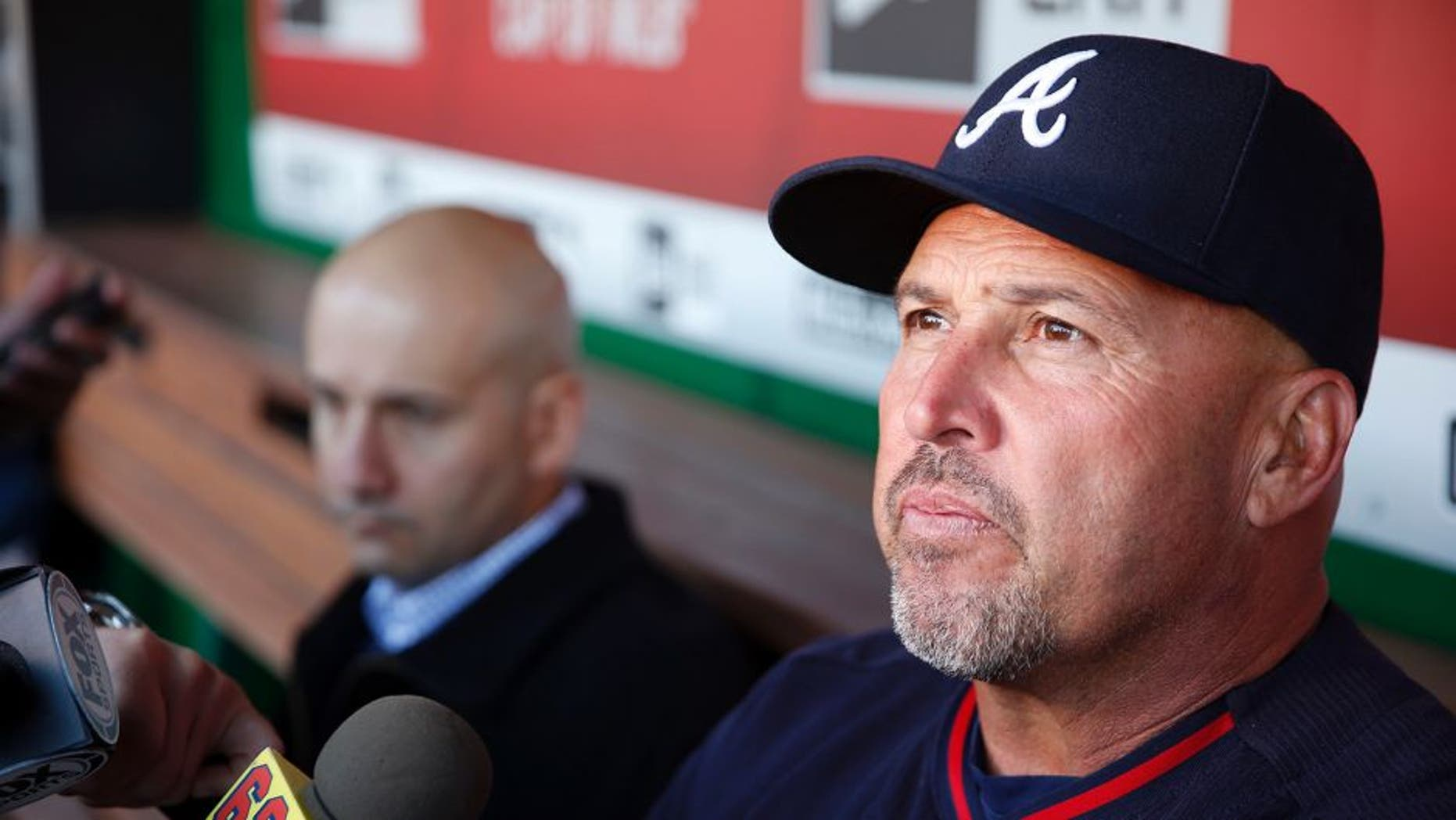 FILE - In this April 13, 2016, file photo, Atlanta Braves manager Fredi Gonzalez, right, with general manager John Coppolella sitting at left, talks with the media before a baseball game against the Washington Nationals at Nationals Park, in Washington. The Atlanta Braves have fired manager Fredi Gonzalez, who couldn't survive the worst record in the majors. Braves general manager John Coppolella confirmed the firing of Gonzalez, in his sixth season, Tuesday, May 17, 2016. (AP Photo/Alex Brandon, File)