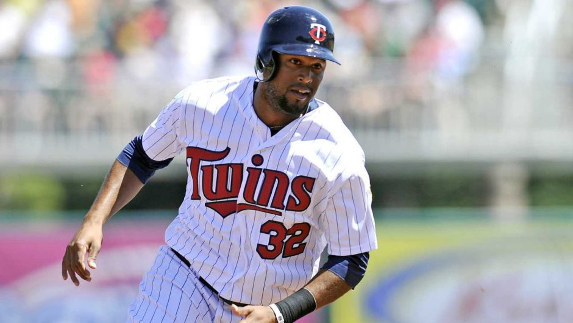 March 13, 2014: Minnesota Twins center fielder Aaron Hicks rounds third base during a game against the Boston Red Sox at Hammond Stadium.