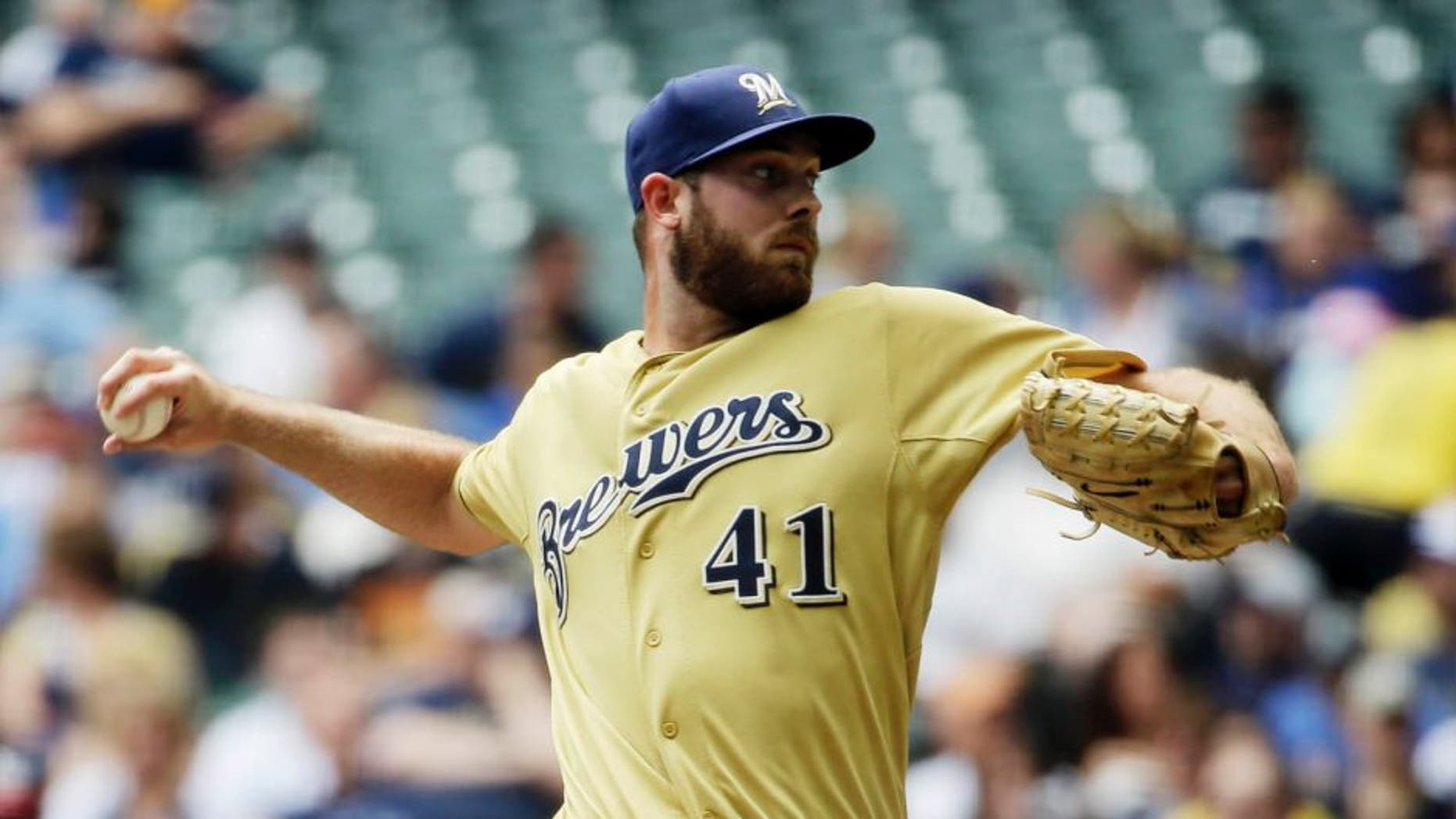 Milwaukee Brewers starting pitcher Taylor Jungmann throws during the first inning against the Washington Nationals, Sunday, June 14, 2015, in Milwaukee.