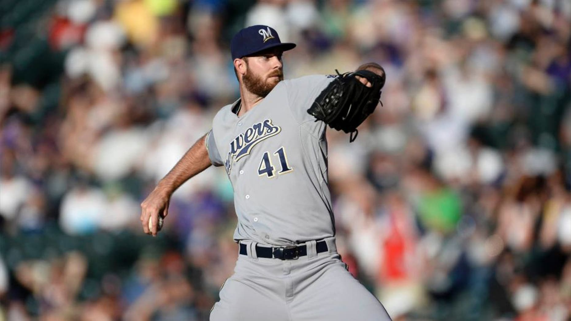 Jun 19, 2015; Denver, CO, USA; Milwaukee Brewers starting pitcher Taylor Jungmann delivers a pitch in the first inning against the Colorado Rockies at Coors Field.