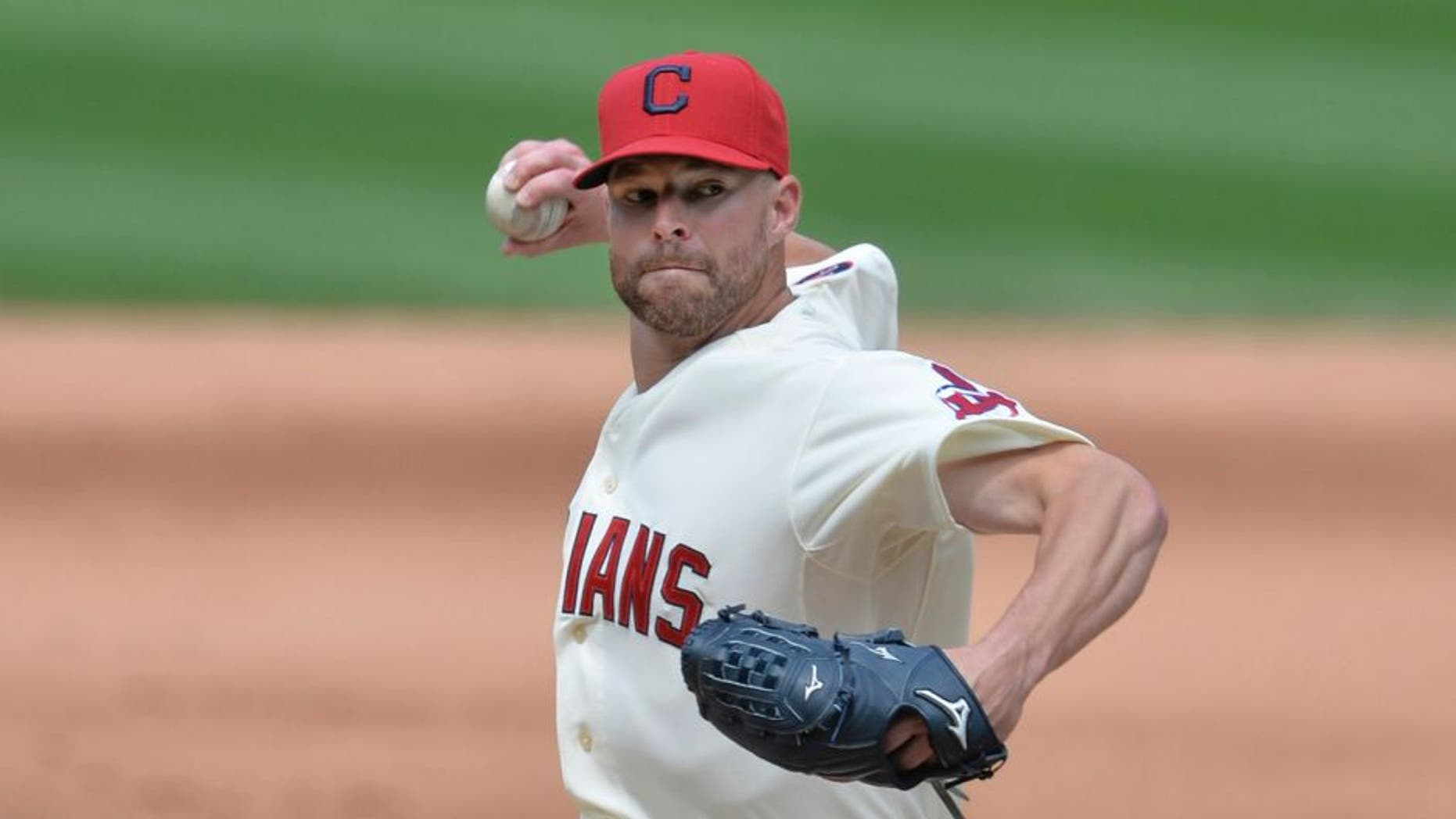 Cleveland Indians starting pitcher Corey Kluber delivers in the sixth inning against the Minnesota Twins at Progressive Field on Sunday, August 9, 2015.