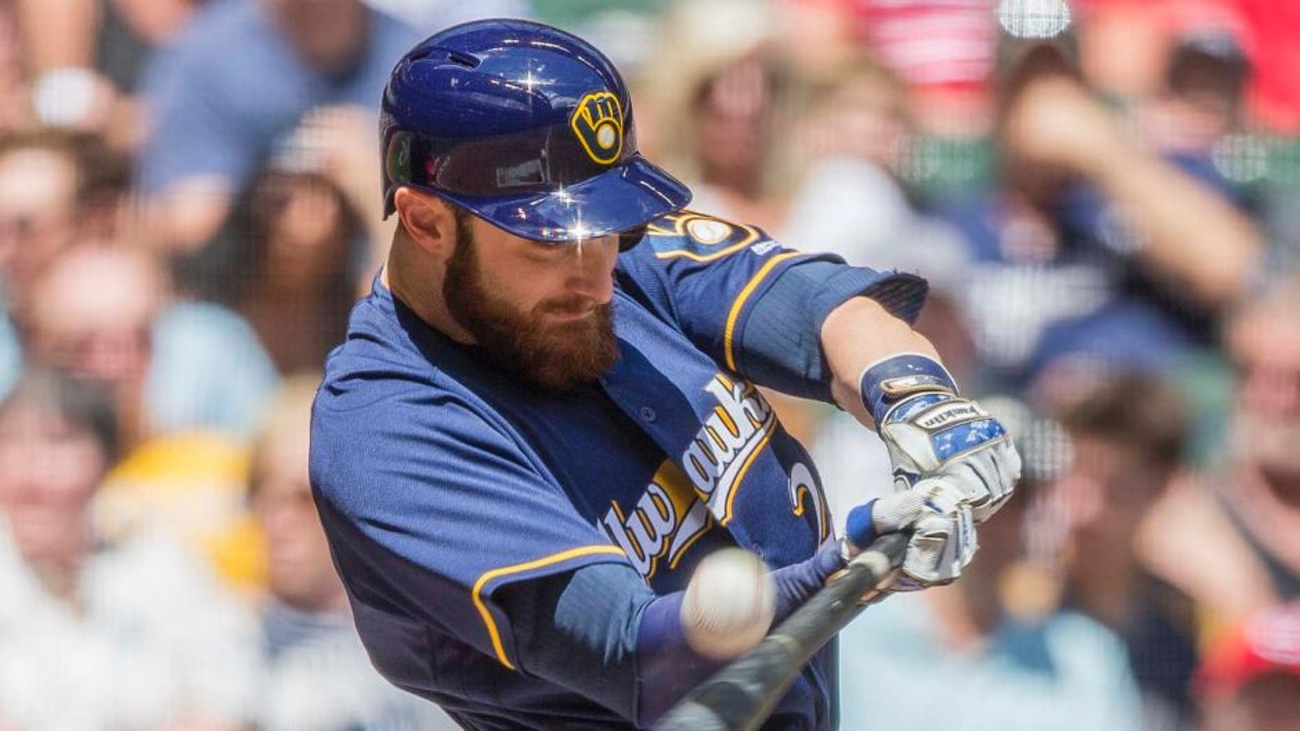 The Milwaukee Brewers' Jonathan Lucroy connects for a sacrifice fly to right off the Cincinnati Reds' Brandon Finnegan during the first inning Sunday, May 29, 2016, in Milwaukee.