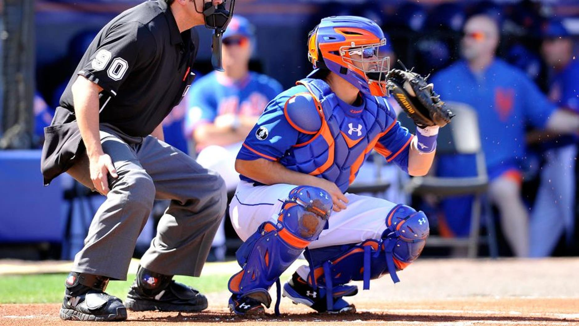 Feb 28, 2014; Port St. Lucie, FL, USA; New York Mets catcher Travis d'Arnaud (15) catches a pitch against the Washington Nationals in spring training action at Tradition Stadium. Mandatory Credit: Brad Barr-USA TODAY Sports