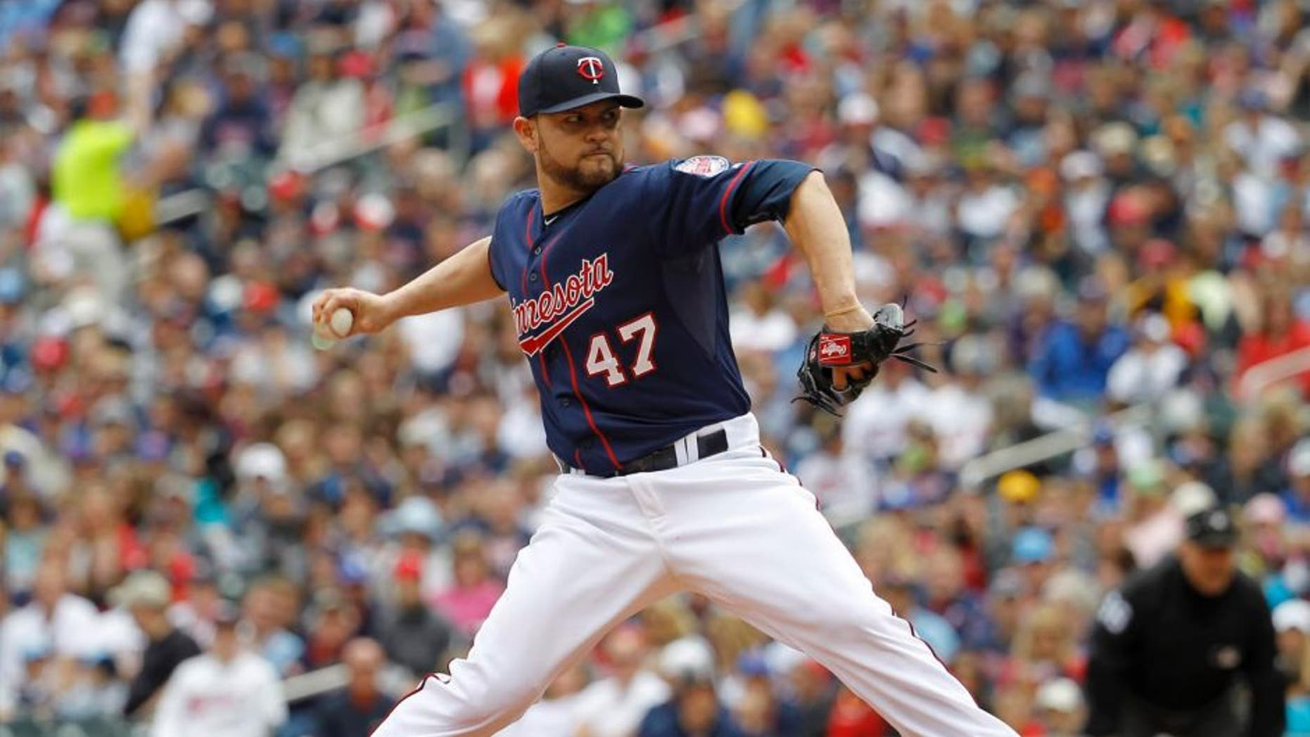 Minnesota Twins starting pitcher Ricky Nolasco delivers to the Toronto Blue Jays during the first inning in Minneapolis, Sunday, May 31, 2015.