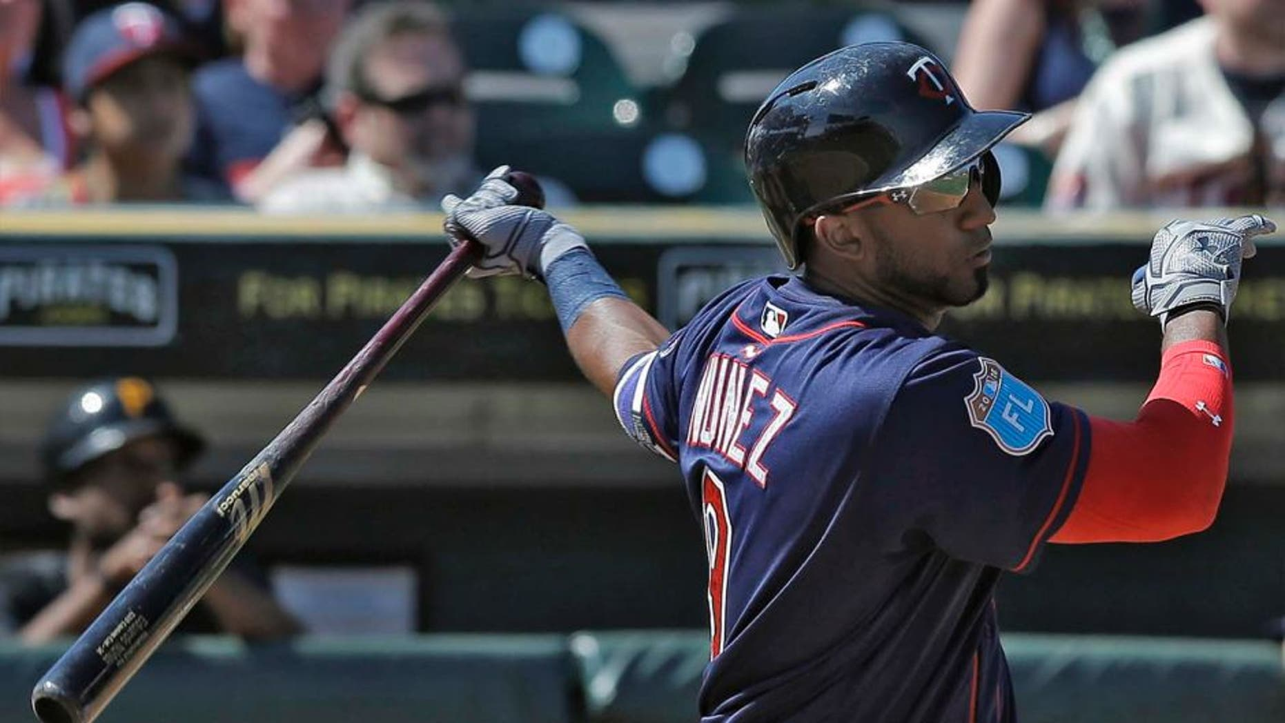 The Minnesota Twins' Eduardo Nunez watches his triple off Pittsburgh Pirates relief pitcher Neftali Feliz during the fourth inning of a spring training baseball game Friday, March 4, 2016, in Bradenton, Fla.