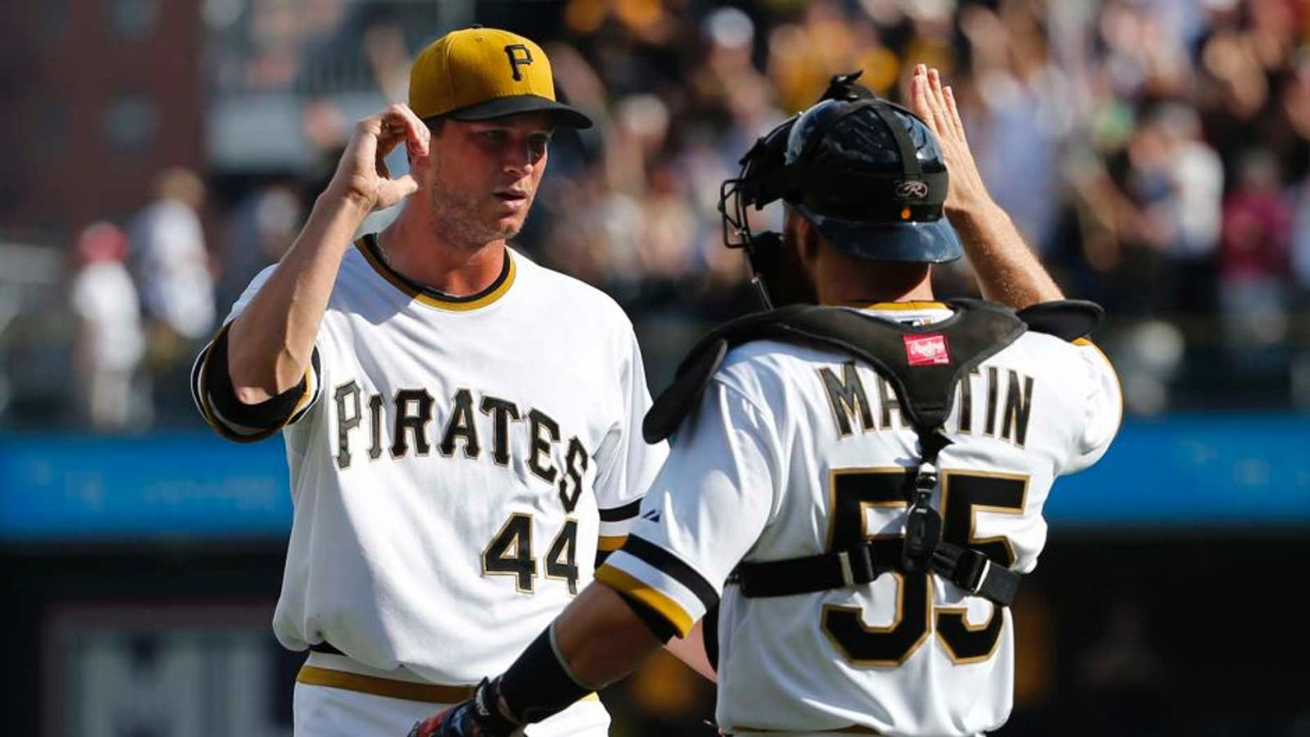 Sunday, September 21: Pittsburgh Pirates relief pitcher Tony Watson (left) celebrates with catcher Russell Martin after getting the final out of the ninth inning. The Pirates won 1-0.