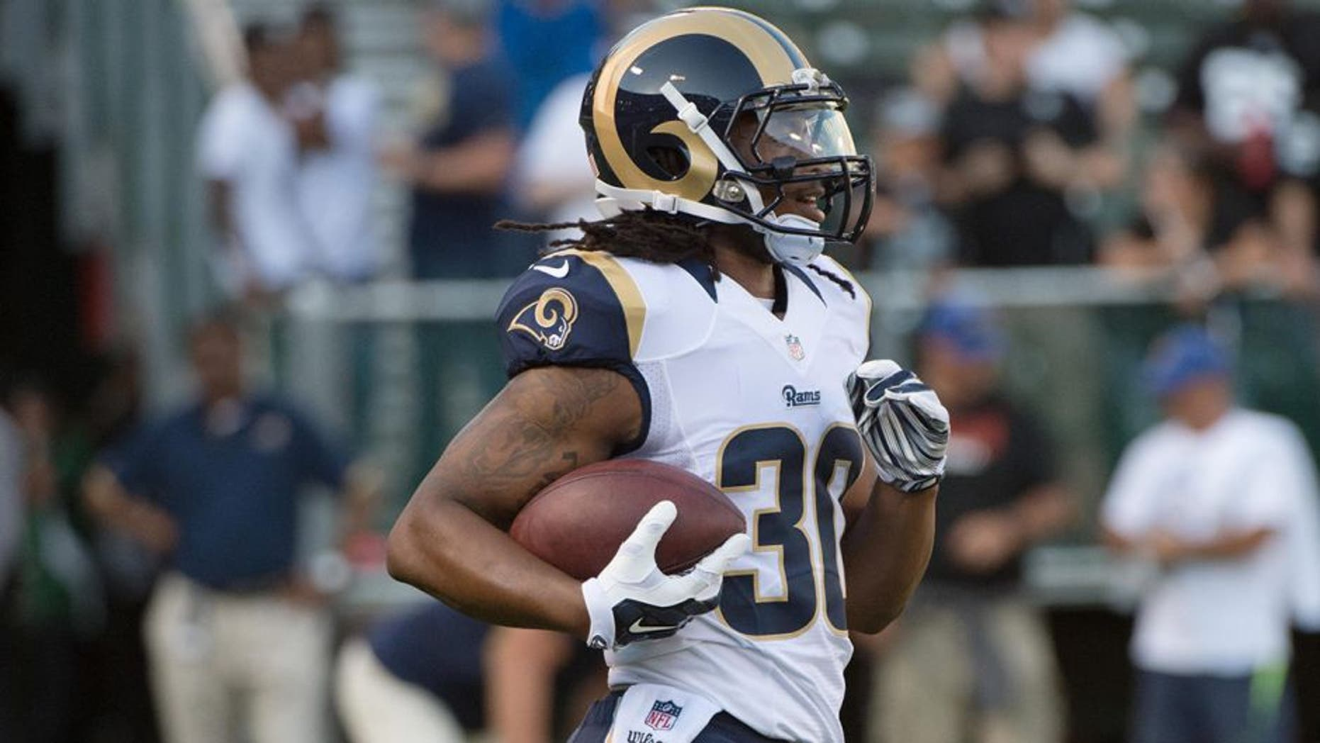 August 14, 2015; Oakland, CA, USA; St. Louis Rams running back Todd Gurley (30) warms up before a preseason NFL football game against the Oakland Raiders at O.co Coliseum. The Raiders defeated the Rams 18-3. Mandatory Credit: Kyle Terada-USA TODAY Sports
