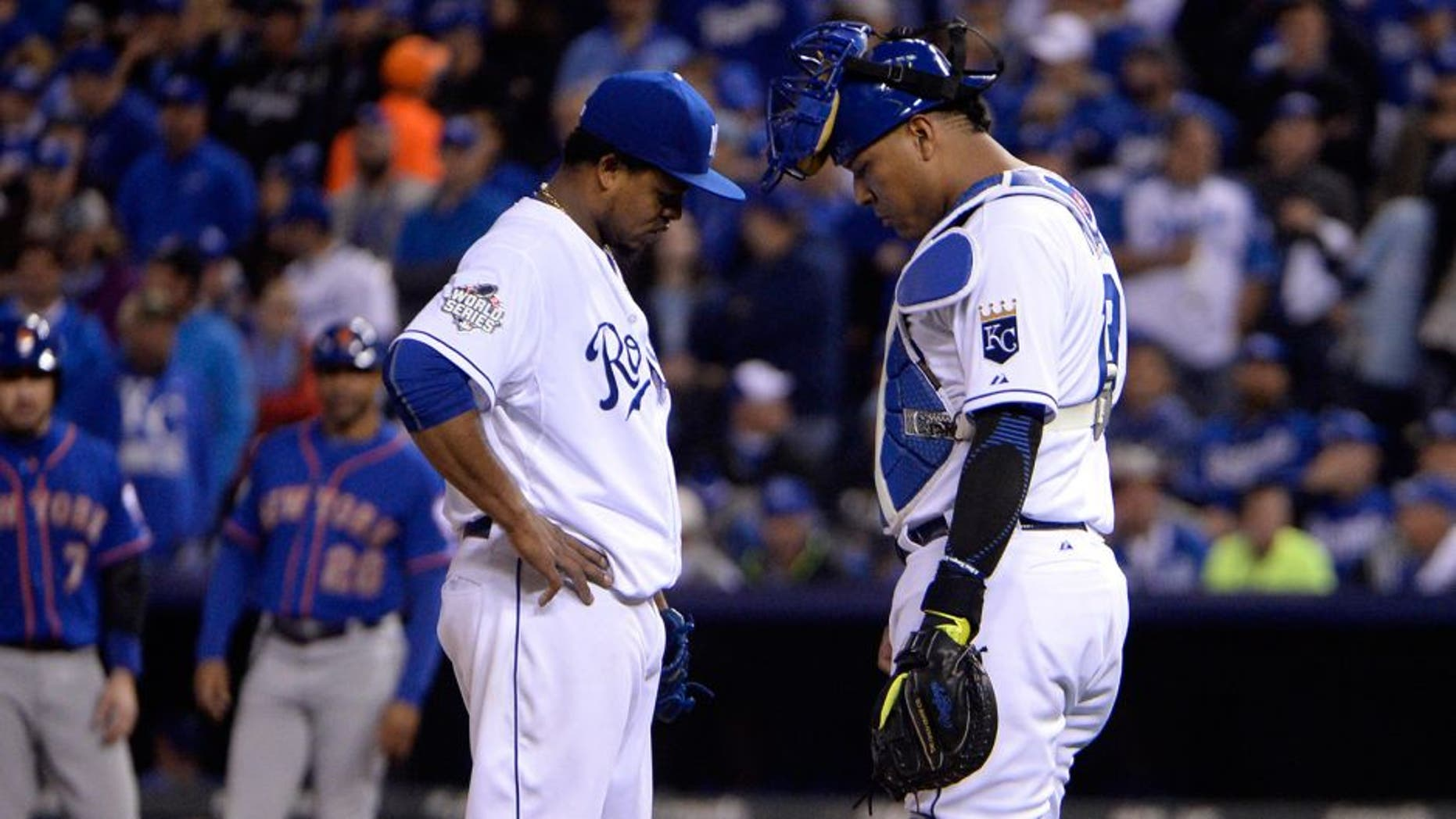 Oct 27, 2015; Kansas City, MO, USA; Kansas City Royals starting pitcher Edinson Volquez (left) talks with catcher Salvador Perez (right) in the fourth inning in game one of the 2015 World Series at Kauffman Stadium. Mandatory Credit: John Rieger-USA TODAY Sports