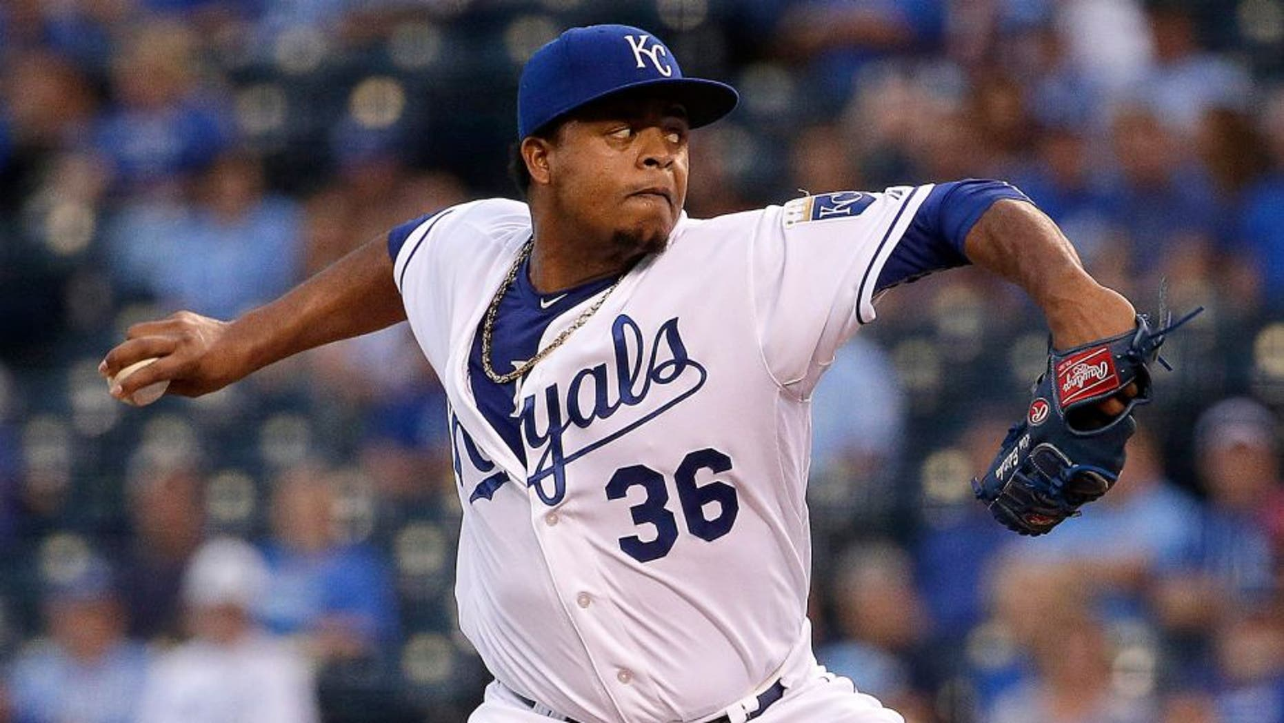 Kansas City Royals starting pitcher Edinson Volquez throws during the first inning of a baseball game against the Minnesota Twins Tuesday, Sept. 8, 2015, in Kansas City, Mo. (AP Photo/Charlie Riedel)
