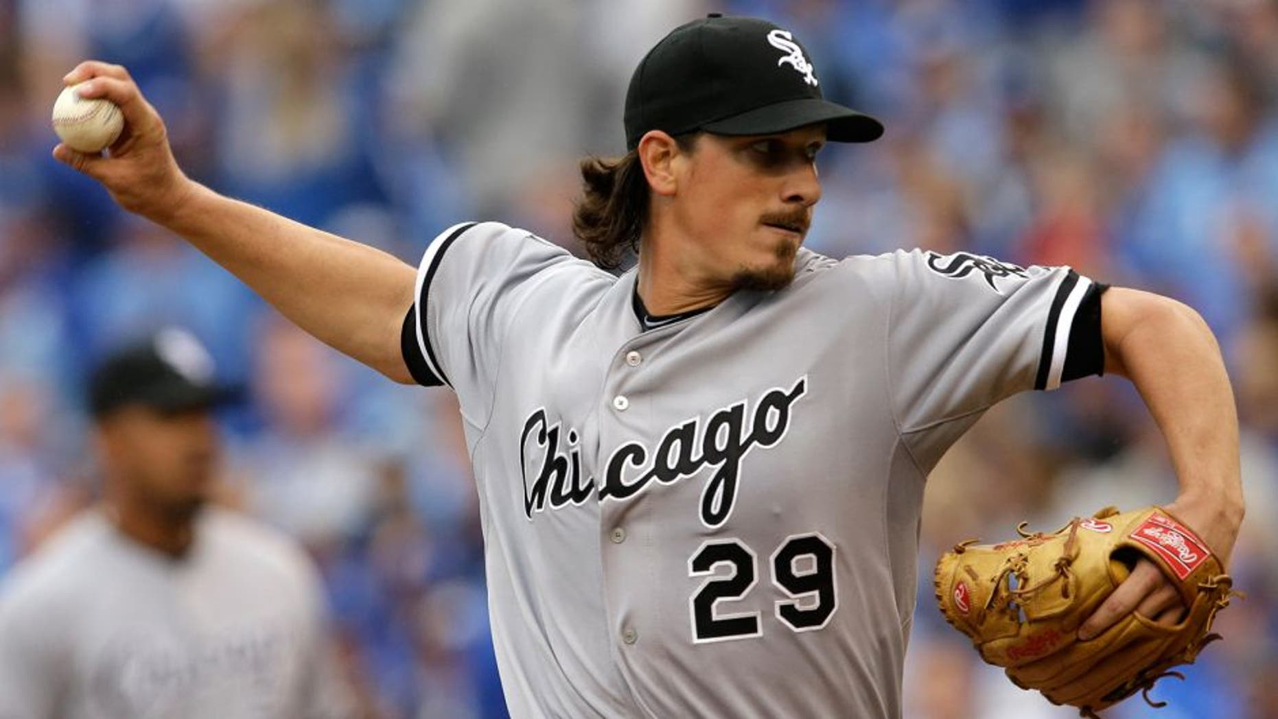 Chicago White Sox starting pitcher Jeff Samardzija (29) delivers to a Kansas City Royals batter during the first inning an opening day baseball game at Kauffman Stadium in Kansas City, Mo., Monday, April 6, 2015. (AP Photo/Orlin Wagner)