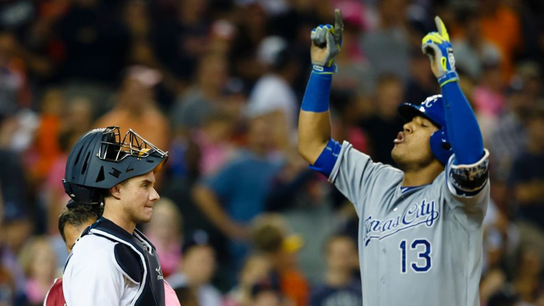 Sep 18, 2015; Detroit, MI, USA; Detroit Tigers catcher James McCann (34) reacts as Kansas City Royals catcher Salvador Perez (13) celebrates his two run home run in the ninth inning at Comerica Park. Mandatory Credit: Rick Osentoski-USA TODAY Sports