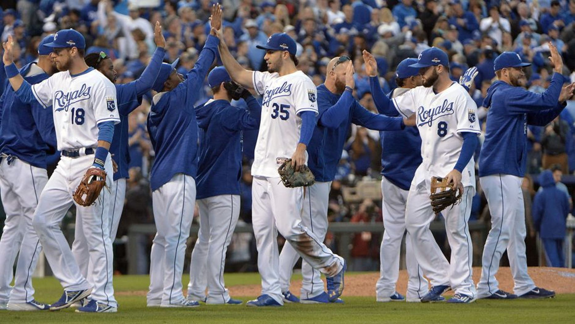 Oct 17, 2015; Kansas City, MO, USA; Kansas City Royals first baseman Eric Hosmer (35) celebrates with teammate after beating the Toronto Blue Jays in game two of the ALCS at Kauffman Stadium. Mandatory Credit: Denny Medley-USA TODAY Sports