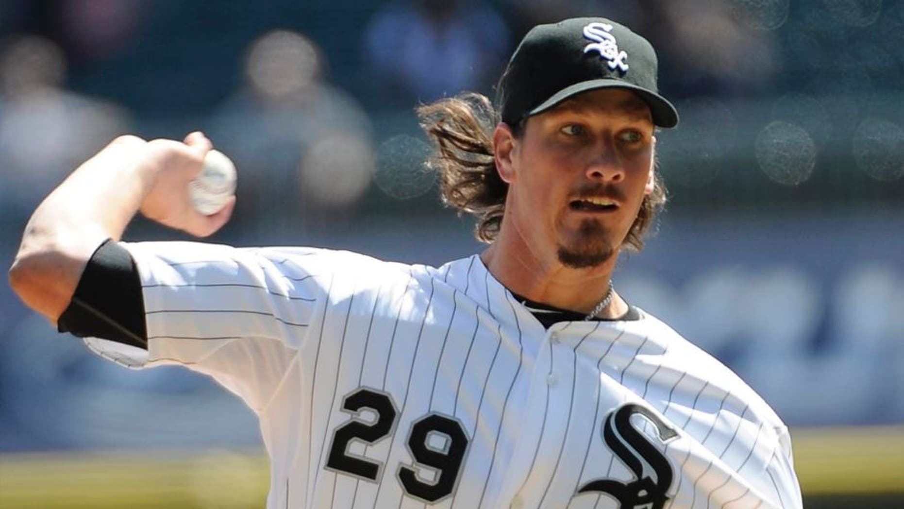 Chicago White Sox starting pitcher Jeff Samardzija throws against the Minnesota Twins during the first inning of a baseball game, Saturday, April 11, 2015 in Chicago.