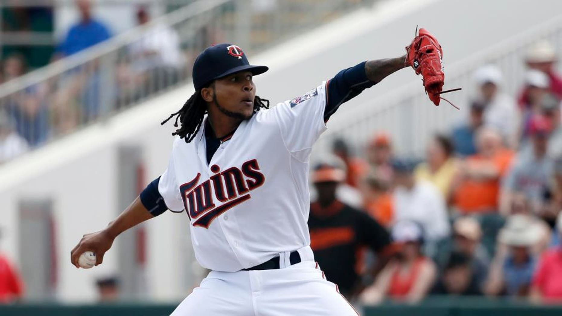 The Minnesota Twins' Ervin Santana works against the Baltimore Orioles in the first inning of a spring training game in Fort Myers, Fla., Sunday, March 8, 2015.