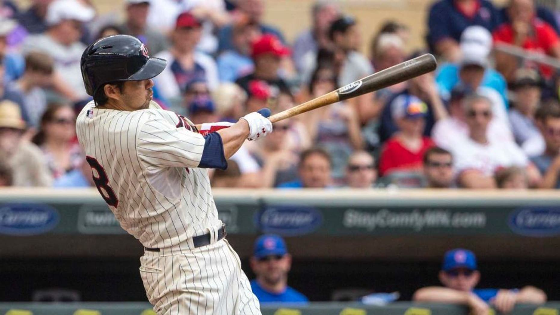 Jun 20, 2015; Minneapolis, MN, USA; Minnesota Twins catcher Kurt Suzuki hits a home run in the second inning against the Chicago Cubs at Target Field.