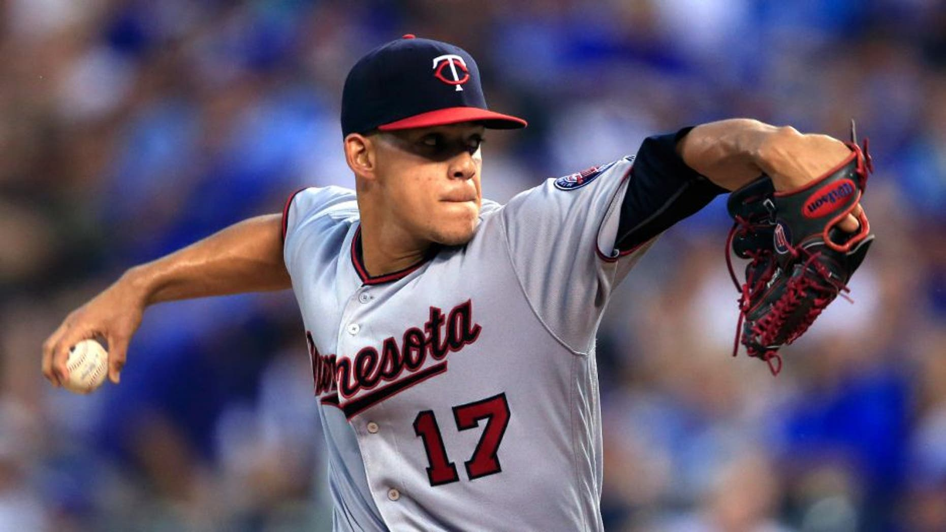 Minnesota Twins starting pitcher Jose Berrios delivers to a Kansas City Royals batter during the first inning of a baseball game at Kauffman Stadium in Kansas City, Mo., Friday, Aug. 19, 2016.