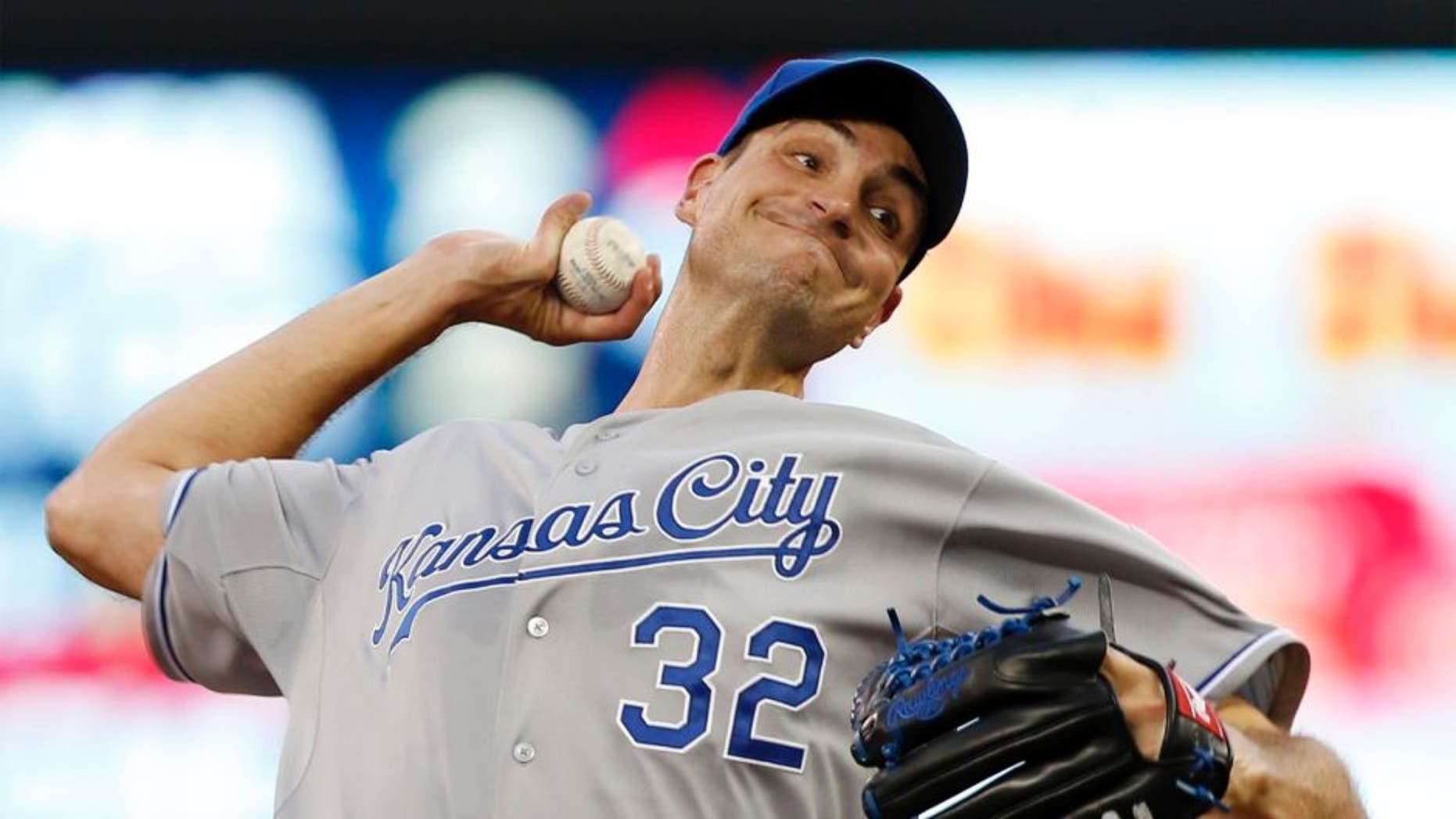 Kansas City Royals pitcher Chris Young throws against the Minnesota Twins during the first inning Tuesday, June 9, 2015, in Minneapolis.
