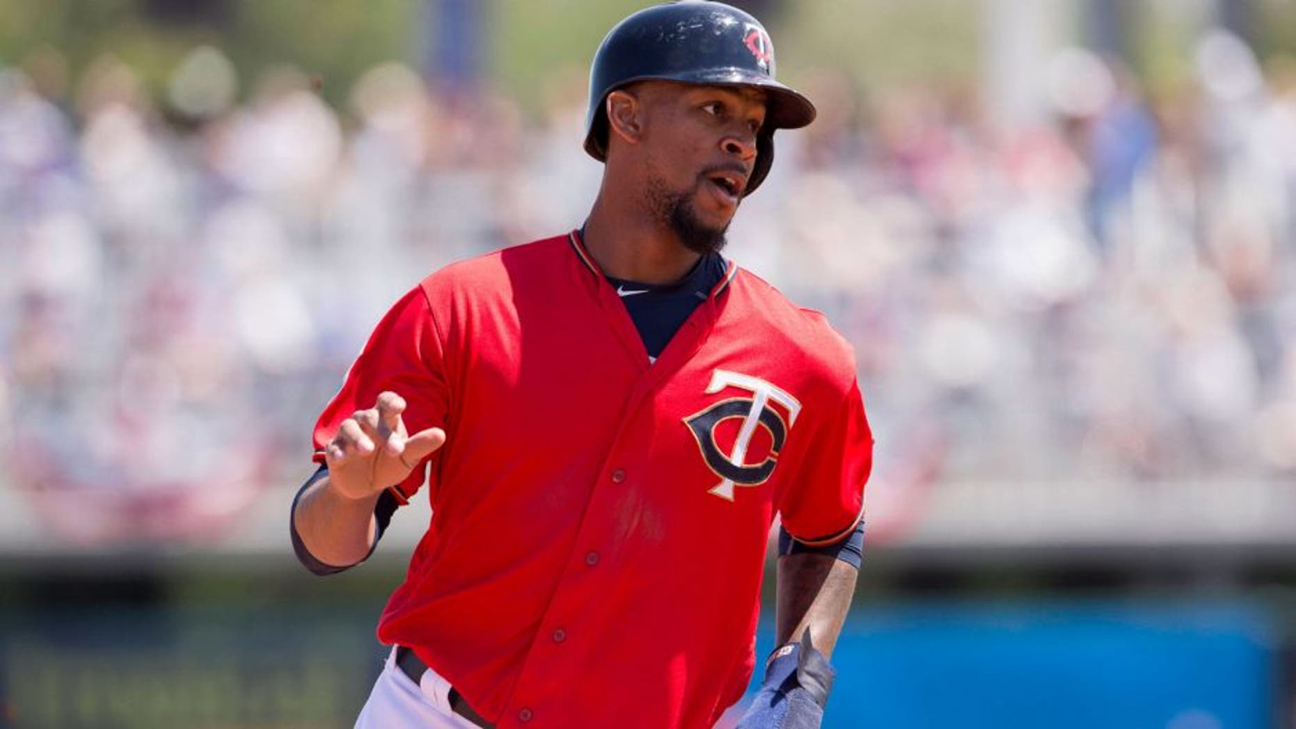 Minnesota Twins designated hitter Byron Buxton runs to third base.