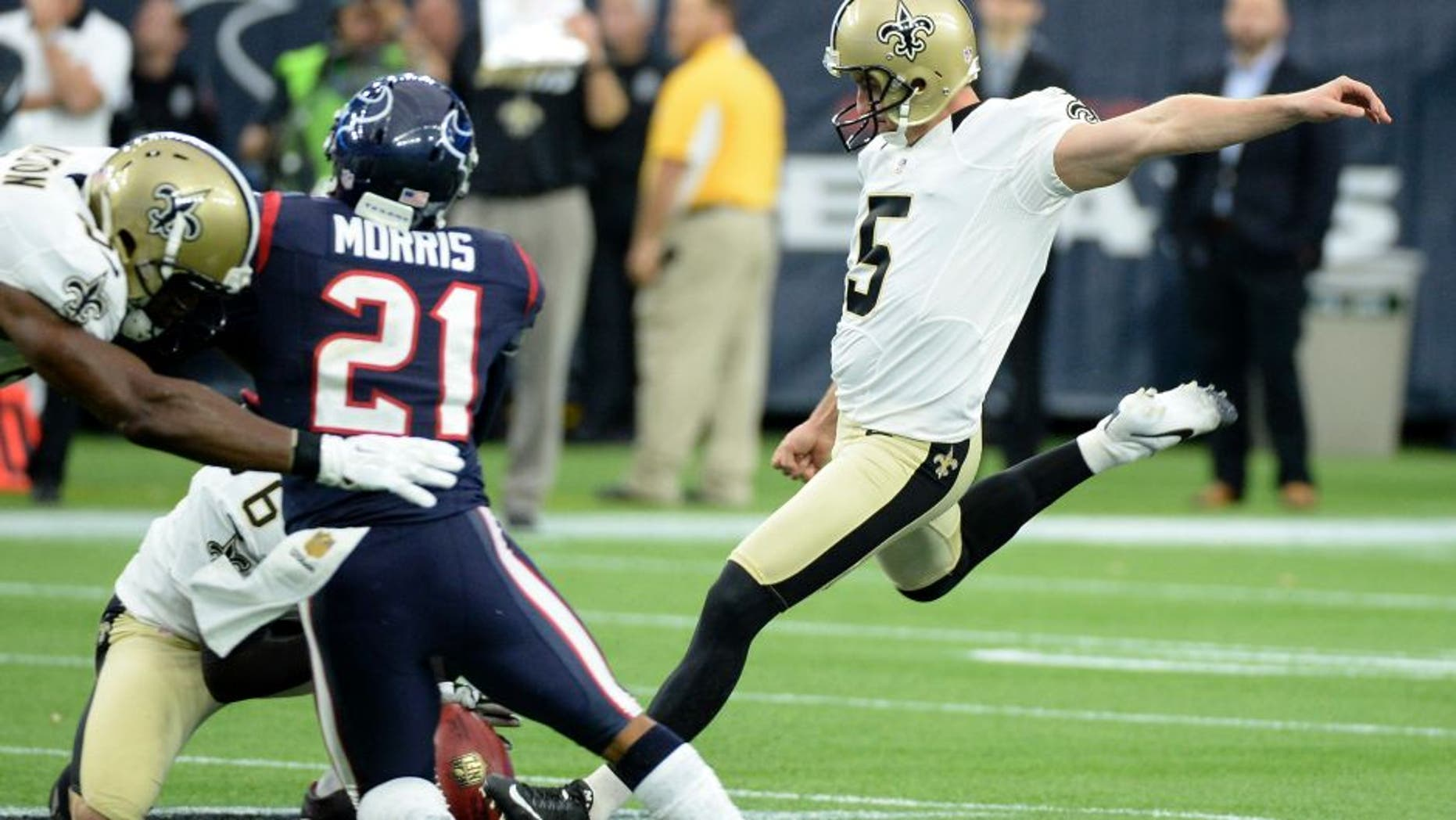 FILE - In this Nov. 29, 2015, file photo, then-New Orleans Saints kicker Kai Forbath (5) kicks a 57-yard field goal during the second quarter of an NFL football game against the Houston Texans, in Houston. Another loss has triggered another round of changes for Minnesota, with new kicker Kai Forbath leading the list as the Vikings try to stop their freefall by letting the struggling Blair Walsh go.(AP Photo/George Bridges, File)