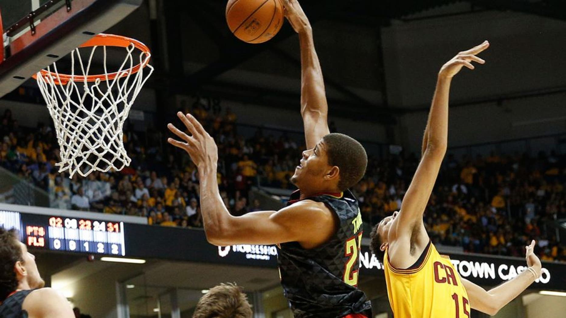 Atlanta Hawks center Walter Tavares (22) shoots over Cleveland Cavaliers forward Austin Daye (15) in the second half of an NBA preseason basketball game, Wednesday, Oct. 7, 2015, in Cincinnati. The Hawks won 98-96. (AP Photo/John Minchillo)