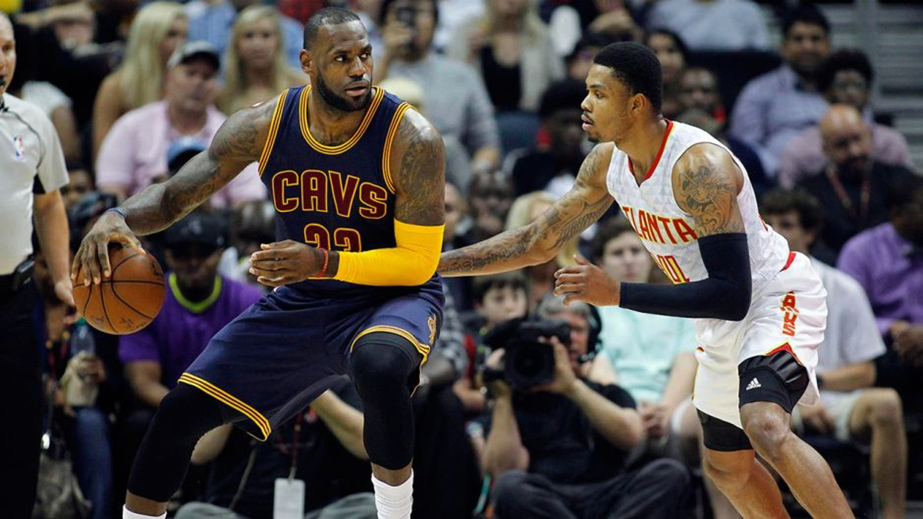 Apr 1, 2016; Atlanta, GA, USA; Cleveland Cavaliers forward LeBron James (23) is defended by Atlanta Hawks forward Kent Bazemore (24) in the first quarter at Philips Arena. Mandatory Credit: Brett Davis-USA TODAY Sports