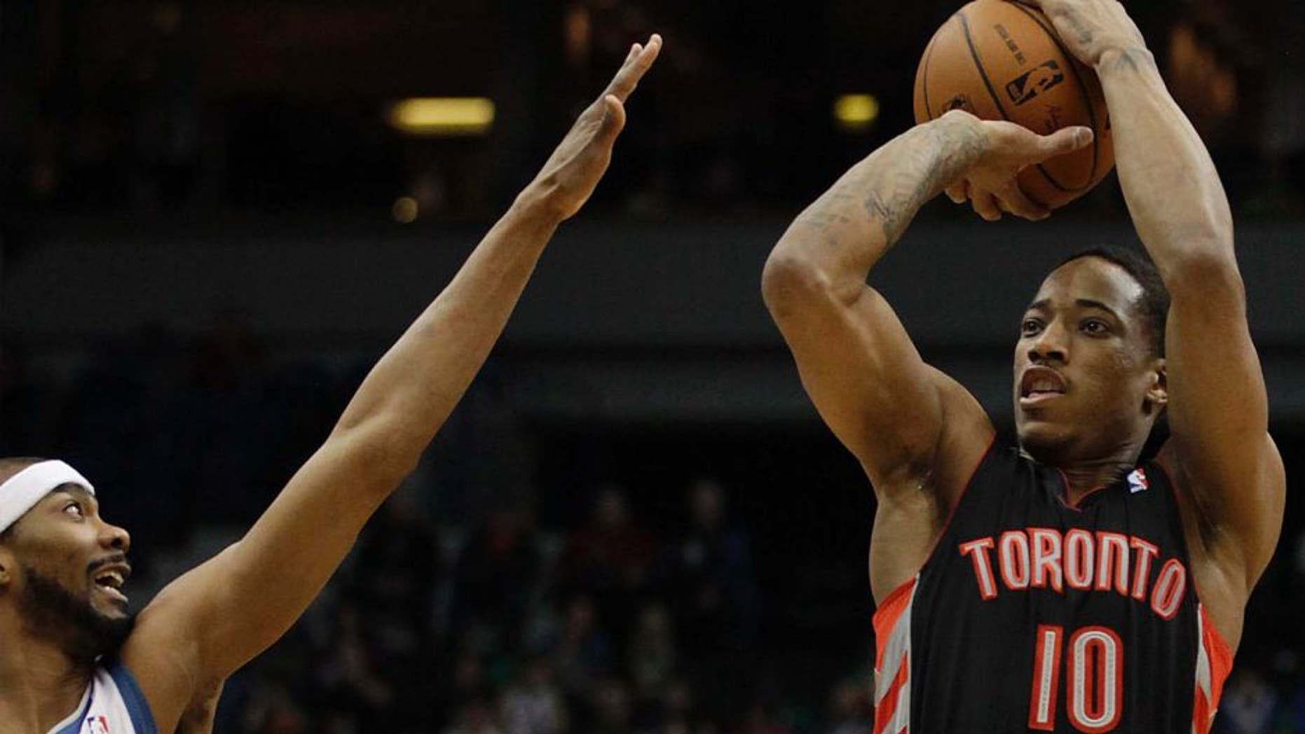 Toronto Raptors guard DeMar DeRozan (right) shoots against Minnesota Timberwolves guard Corey Brewer in the first half.