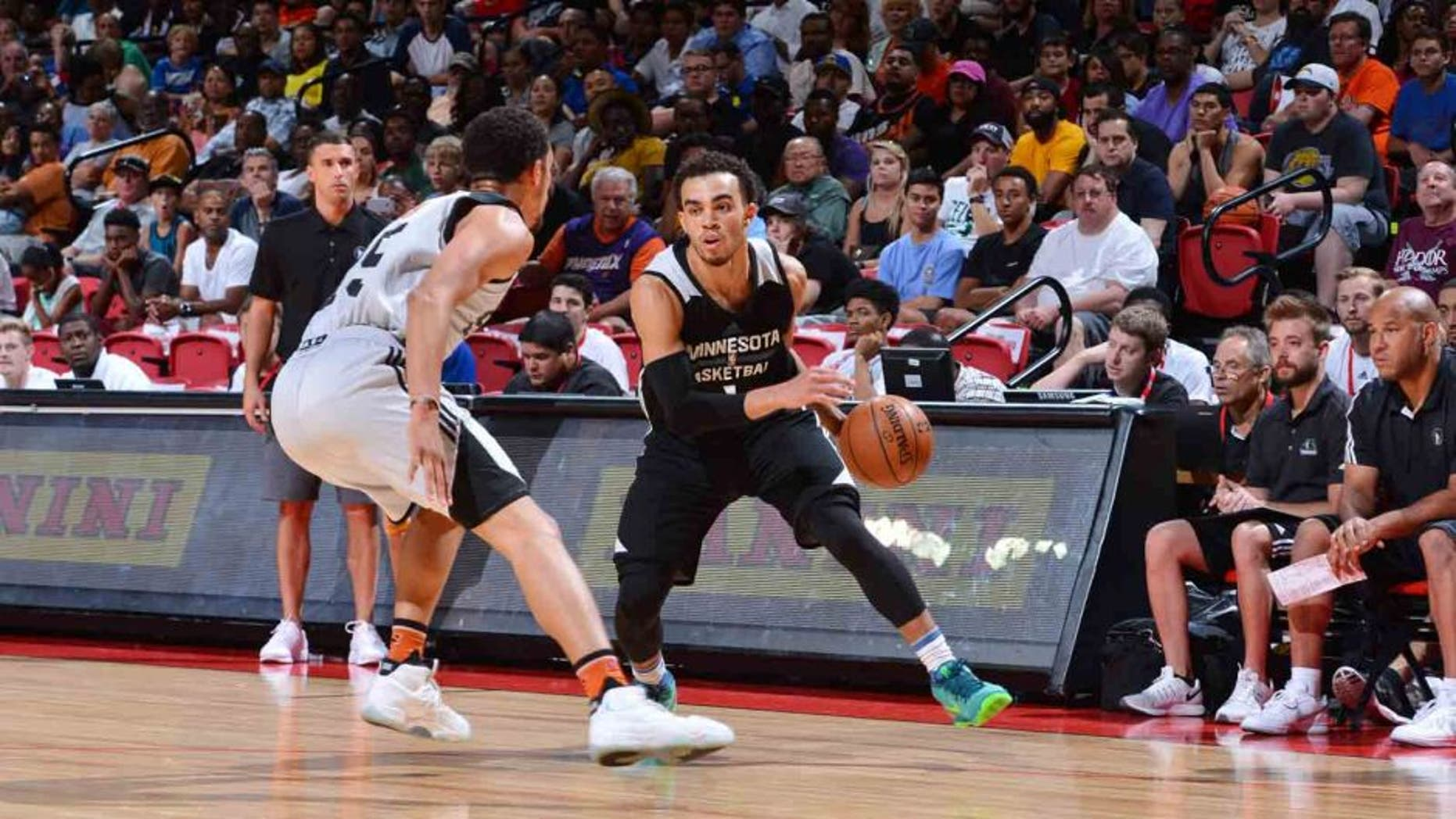 The Minnesota Timberwolves' Tyus Jones handles the ball against the Phoenix Suns during a 2016 NBA Las Vegas Summer League tournament semifinal game July 17, 2016, at the Thomas & Mack Center in Las Vegas.