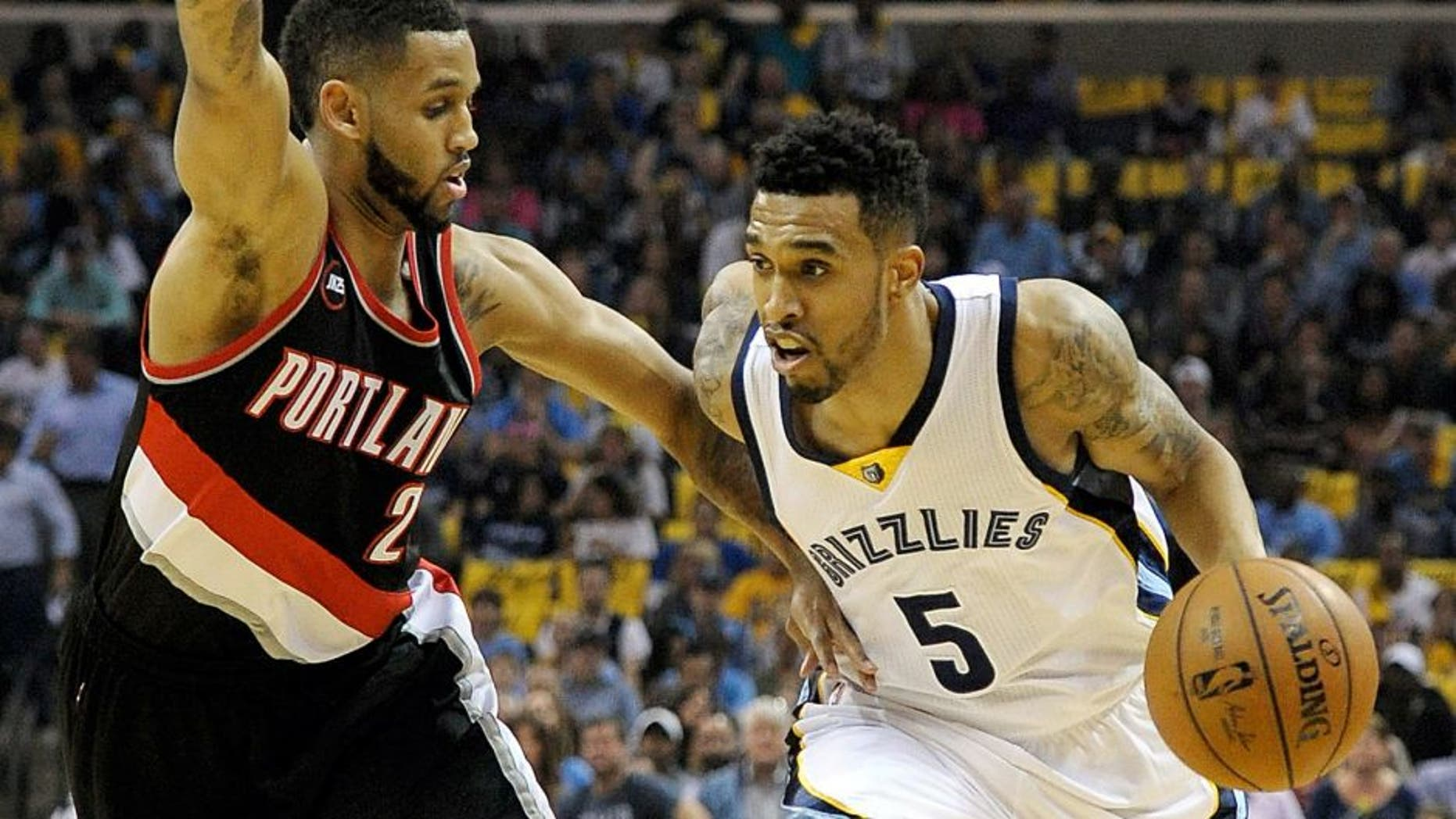 Apr 22, 2015; Memphis, TN, USA; Memphis Grizzlies guard Courtney Lee (5) drives to the basket against Portland Trail Blazers forward Allen Crabbe (23) in game two of the first round of the NBA Playoffs at FedExForum. Mandatory Credit: Justin Ford-USA TODAY Sports