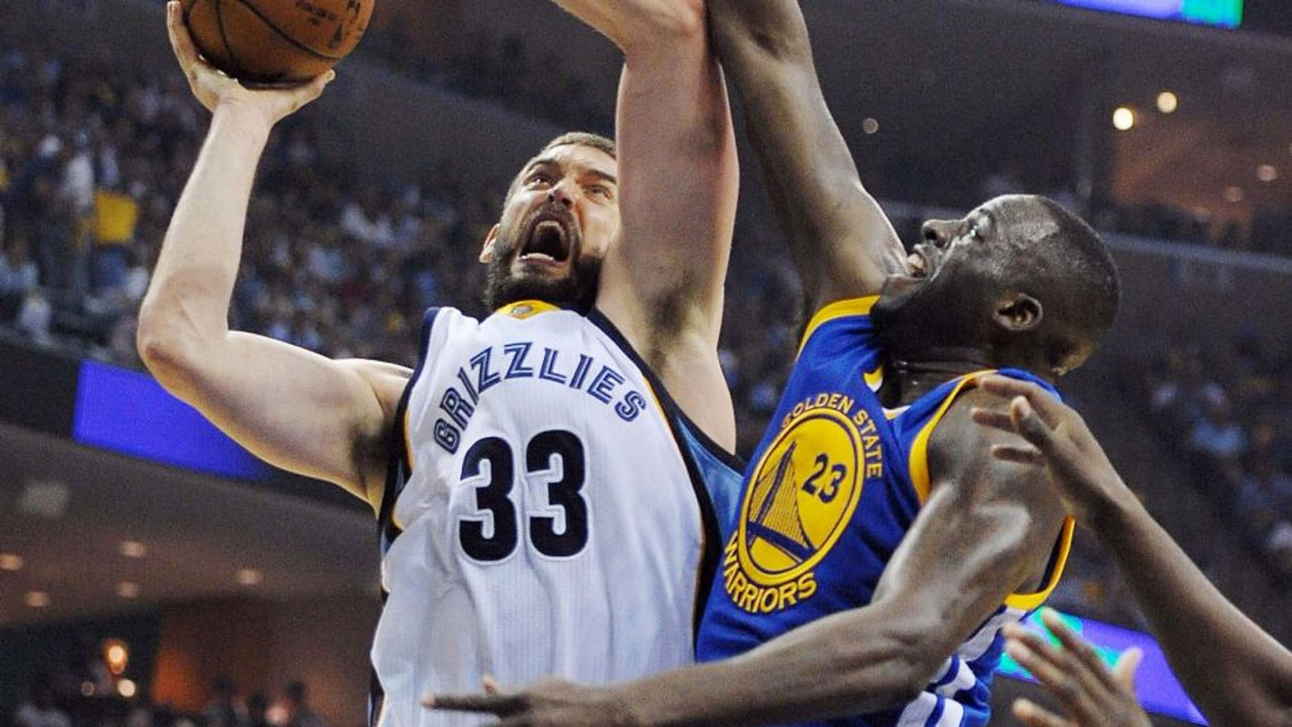 May 9, 2015; Memphis, TN, USA; Memphis Grizzlies center Marc Gasol (33) goes to the basket against Golden State Warriors forward Draymond Green (23) during game three of the second round of the NBA Playoffs at FedExForum. Mandatory Credit: Justin Ford-USA TODAY Sports