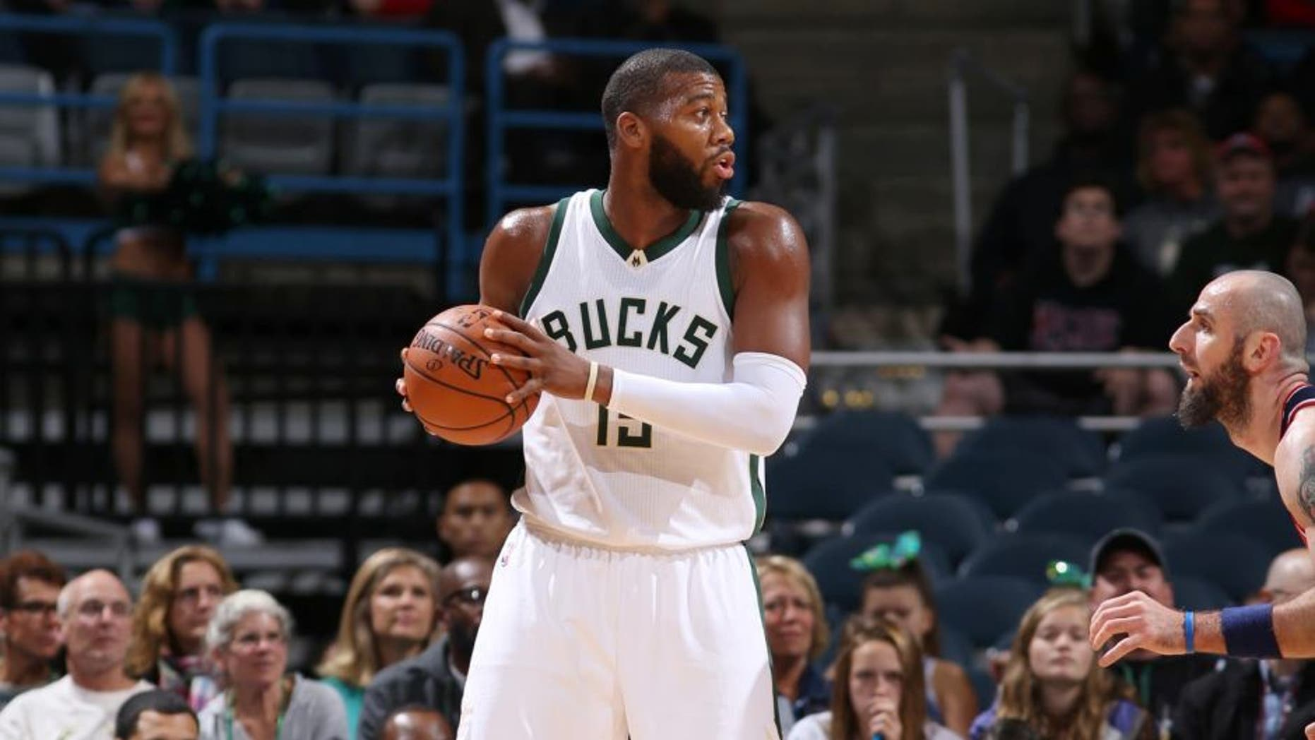 The Milwaukee Bucks' Greg Monroe handles the ball against the Washington Wizards during a preseason game Oct. 17, 2015, at the BMO Harris Bradley Center in Milwaukee, Wis.