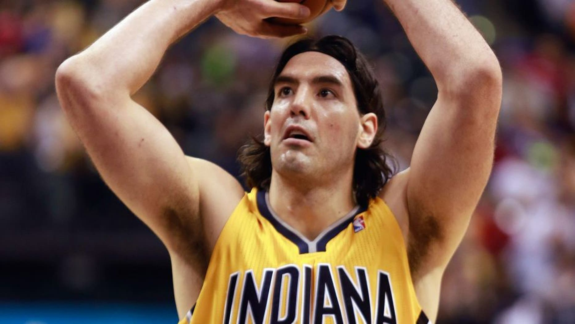 Indiana Pacers forward Luis Scola shoots a free throw against the Chicago Bulls in the second half of an NBA basketball game in Indianapolis, Friday, March 21, 2014. Indiana won 91-79. (AP Photo/R Brent Smith)