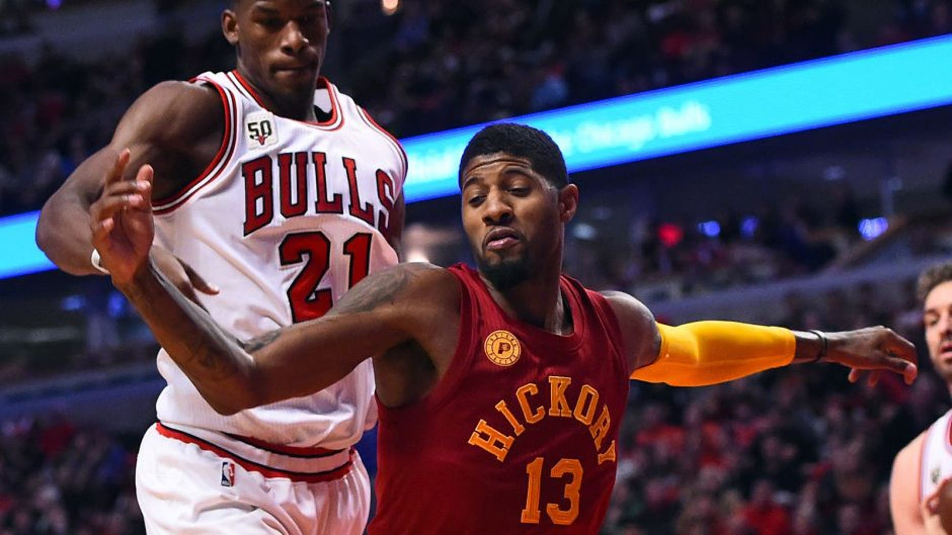 Dec 30, 2015; Chicago, IL, USA; Indiana Pacers forward Paul George (13) knocks the ball away from Chicago Bulls guard Jimmy Butler (21) during the second half at the United Center. Mandatory Credit: Mike DiNovo-USA TODAY Sports