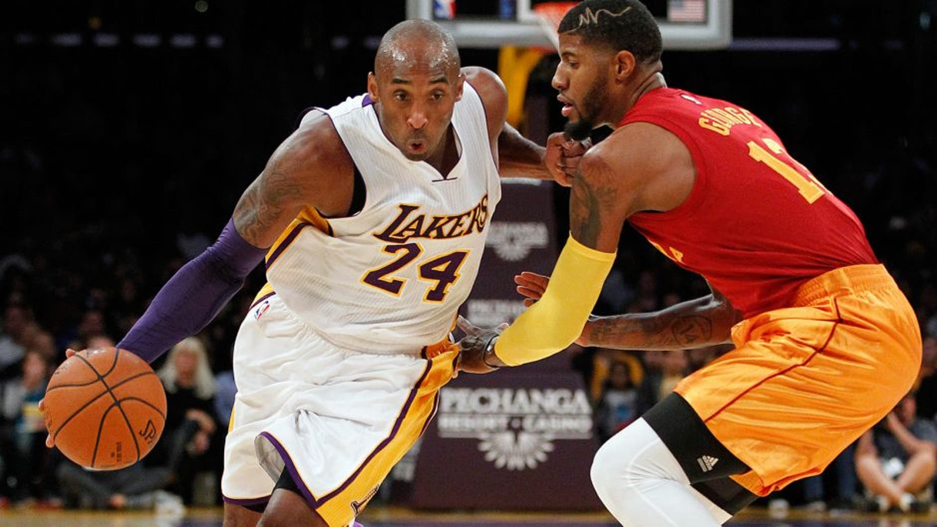Los Angeles Lakers forward Kobe Bryant (24) drives against Indiana Pacers forward Paul George, right, during the first half of an NBA basketball game in Los Angeles, Sunday, Nov. 29, 2015. (AP Photo/Alex Gallardo)