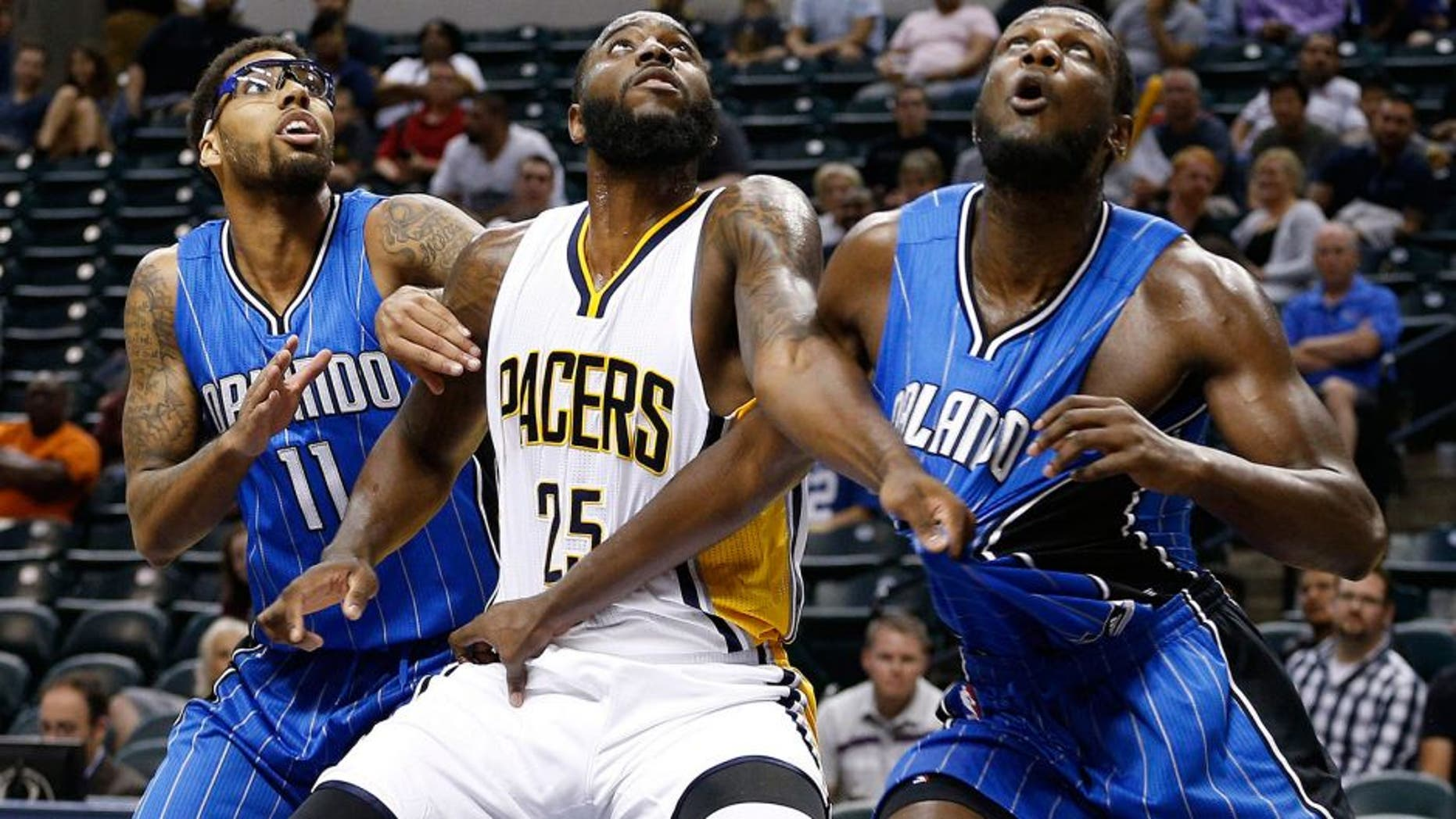 Oct 8, 2015; Indianapolis, IN, USA; Indiana Pacers forward Rakeem Christmas (25) battles for position with Orlando Magic center Nnanna Egwu (21) and forward Devyn Marble (11) at Bankers Life Fieldhouse. The Pacers won 97-92. Mandatory Credit: Brian Spurlock-USA TODAY Sports