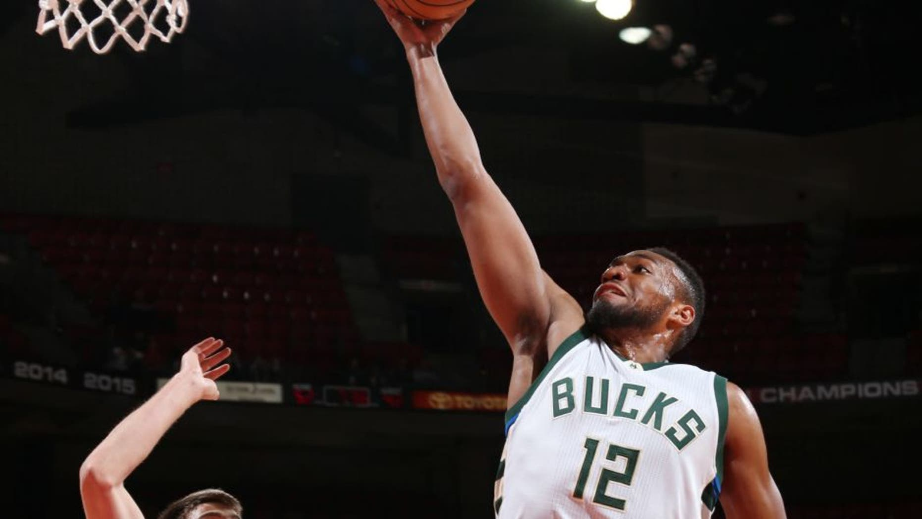 Jabari Parker of the Milwaukee Bucks goes up for a lay up during a preseason game against the Dallas Mavericks.