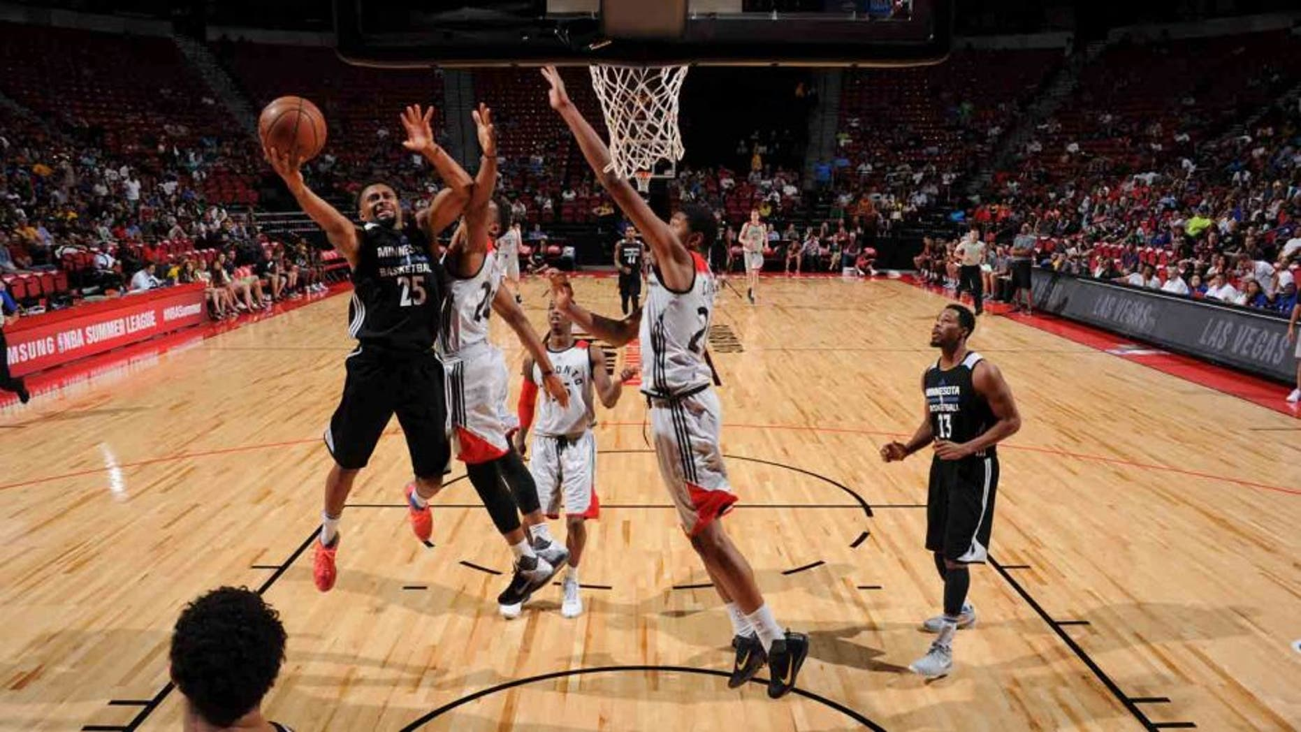 The Minnesota Timberwolves' Xavier Silas shoots the ball against the Toronto Raptors during the 2016 Las Vegas Summer League on July 16, 2016, at the Thomas & Mack Center in Las Vegas.