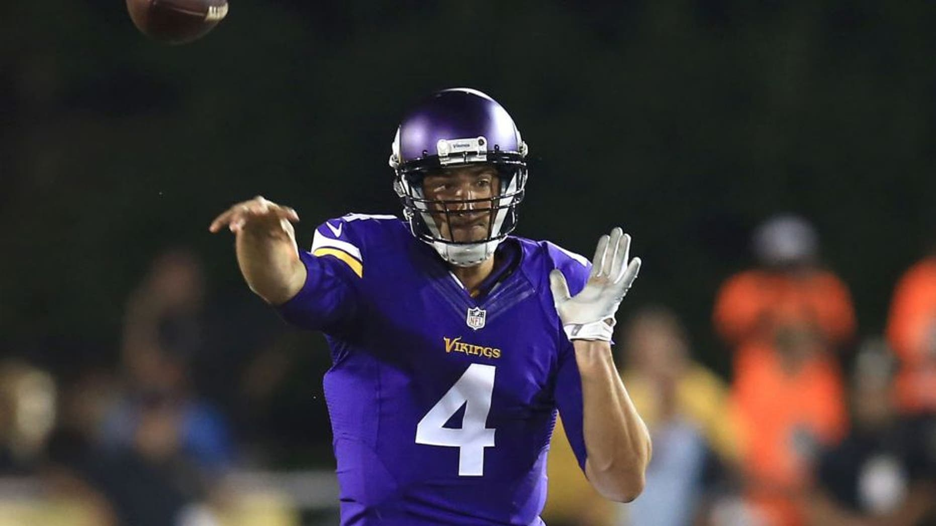 Minnesota Vikings quarterback Mike Kafka throws a pass during the second quarter against the Pittsburgh Steelers at Tom Benson Hall of Fame Stadium in Canton, Ohio, on Sunday, August 9, 2015.