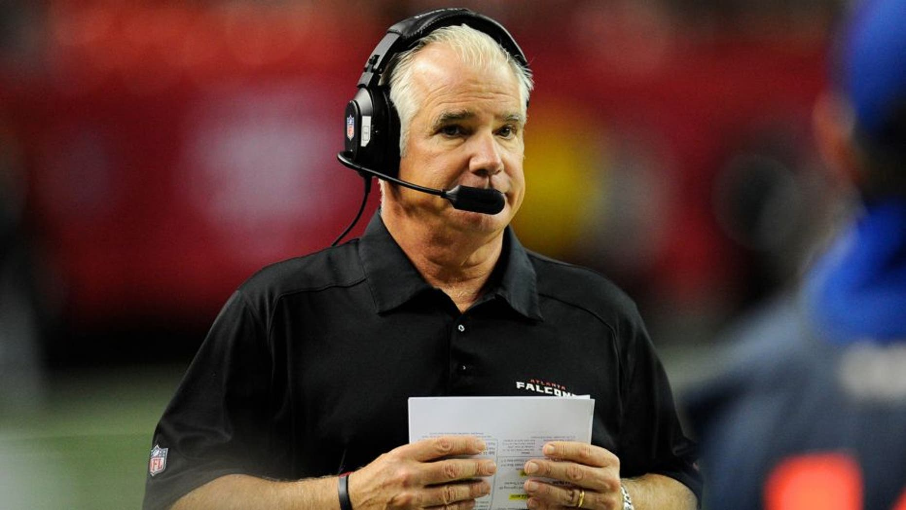 Dec 15, 2013; Atlanta, GA, USA; Atlanta Falcons head coach Mike Smith shown on the sideline against the Washington Redskins during the second half at the Georgia Dome. The Falcons defeated the Redskins 27-26. Mandatory Credit: Dale Zanine-USA TODAY Sports