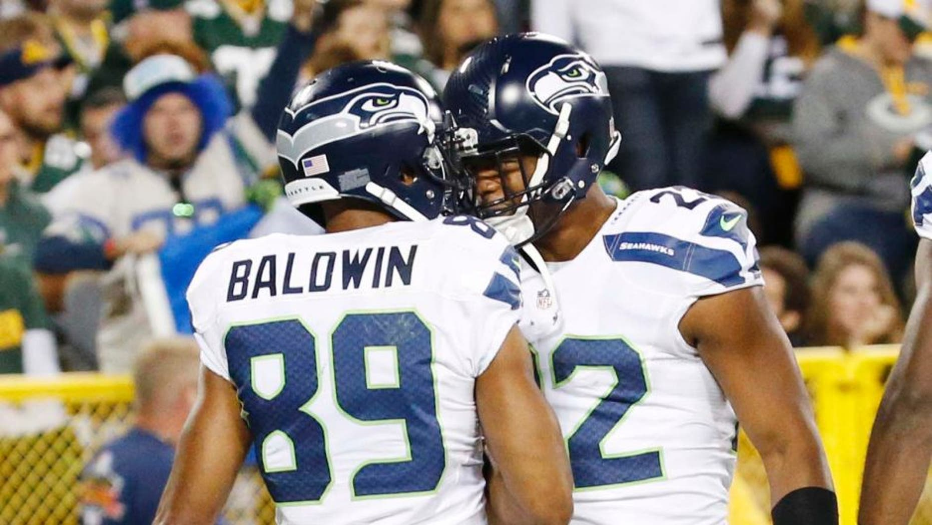 The Seattle Seahawks' Doug Baldwin celebrates his touchdown catch with Fred Jackson during the second half of an NFL football game against the Green Bay Packers on Sunday, Sept. 20, 2015, in Green Bay, Wis.