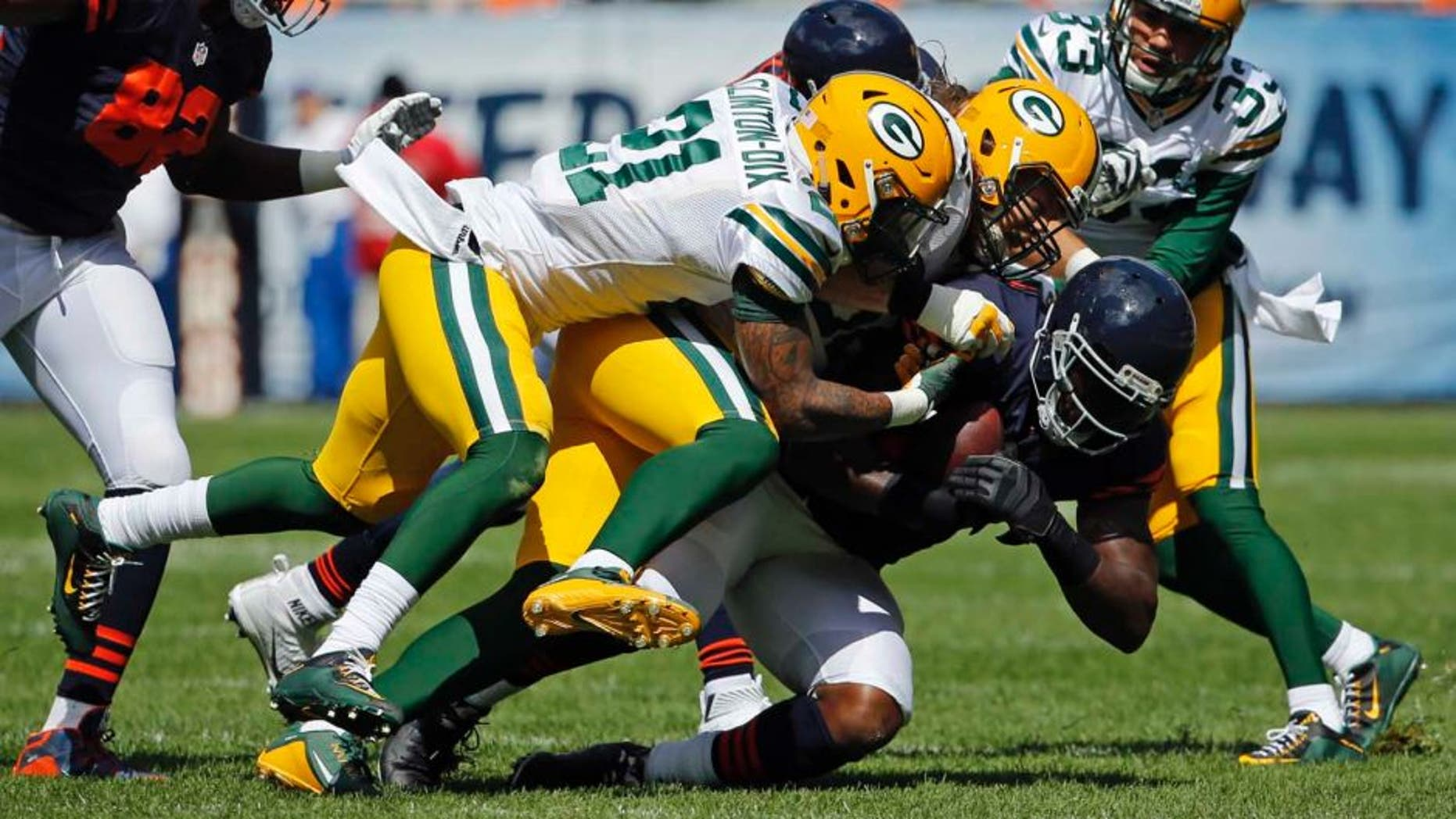Chicago Bears tight end Martellus Bennett is tackled by the Green Bay Packers during the first half of an NFL football game, Sunday, Sept. 13, 2015, in Chicago.