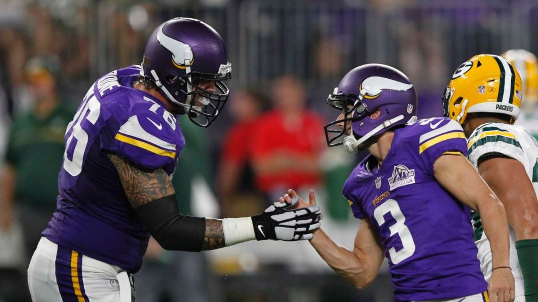 Minnesota Vikings kicker Blair Walsh (right) celebrates with teammate Alex Boone after kicking a 46-yard field goal during the first half against the Green Bay Packers on Sunday, Sept. 18, 2016, in Minneapolis.