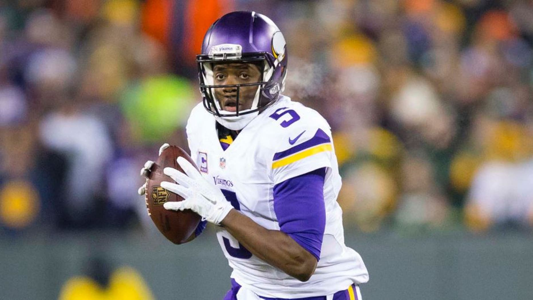 Minnesota Vikings quarterback Teddy Bridgewater looks to pass during the first quarter against the Green Bay Packers at Lambeau Field in Green Bay, Wis., on Sunday, Jan. 3, 2016.