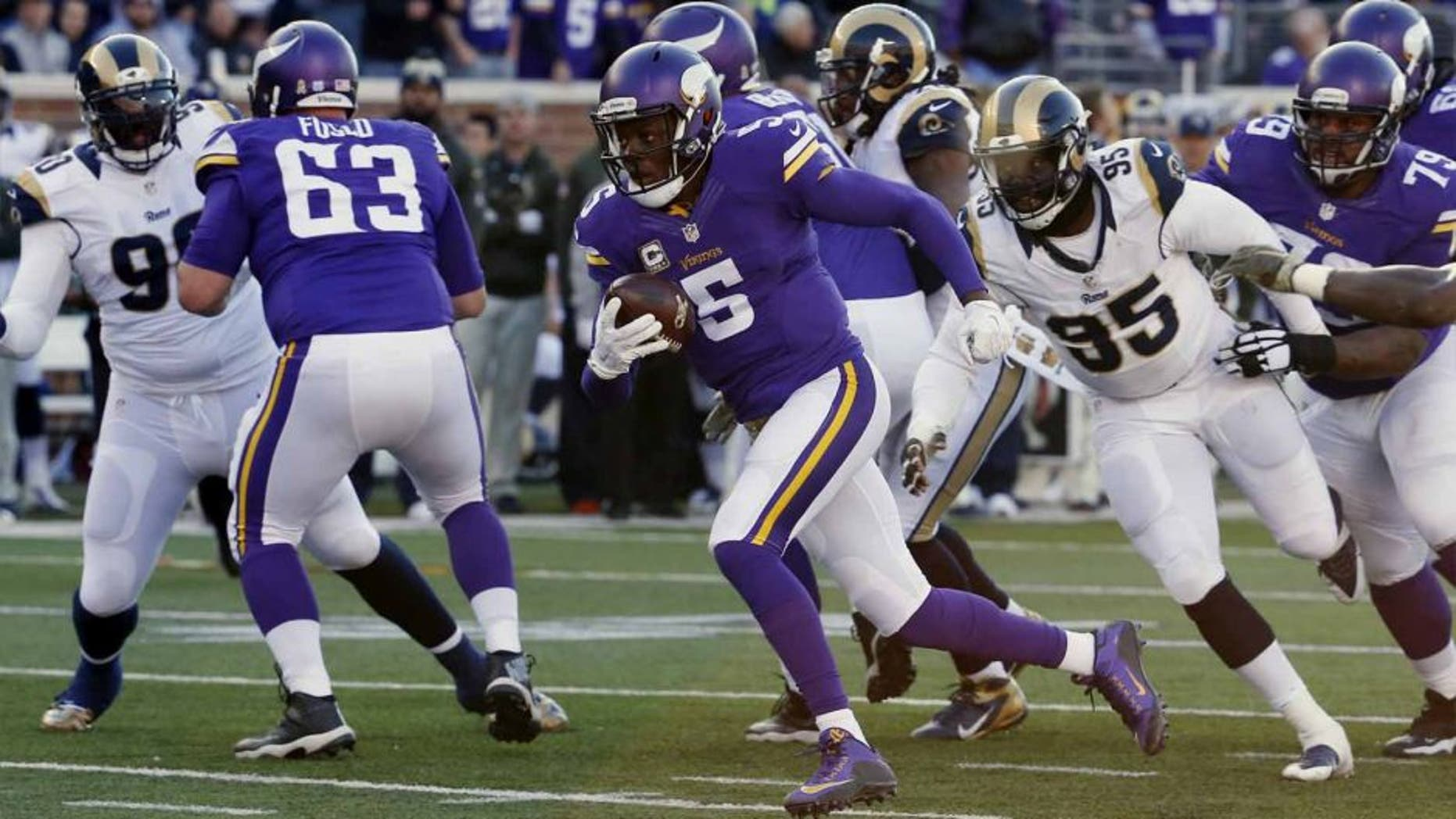 Minnesota Vikings quarterback Teddy Bridgewater breaks away from St. Louis Rams defensive end William Hayes for a touchdown run during the second half of an NFL football game Sunday, Nov. 8, 2015, in Minneapolis.