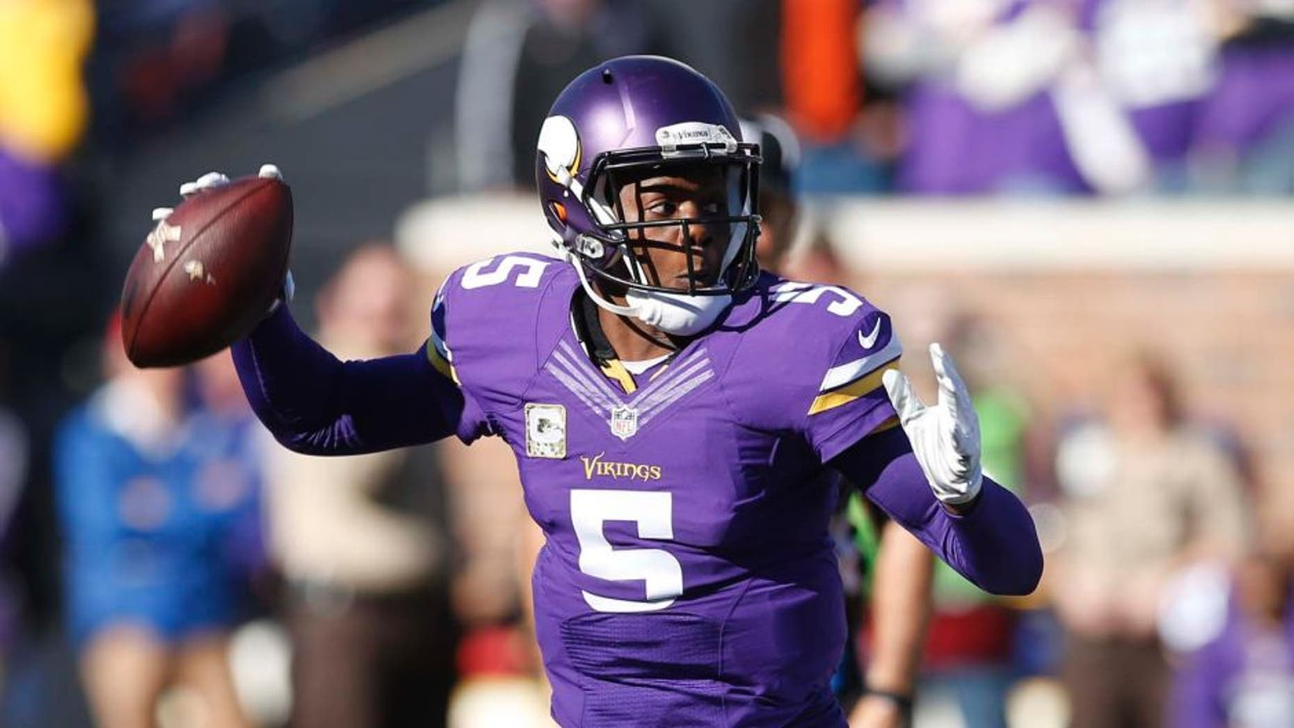 Minnesota Vikings quarterback Teddy Bridgewater prepares to throw during the first half of an NFL football game against the St. Louis Rams on Sunday, Nov. 8, 2015, in Minneapolis.