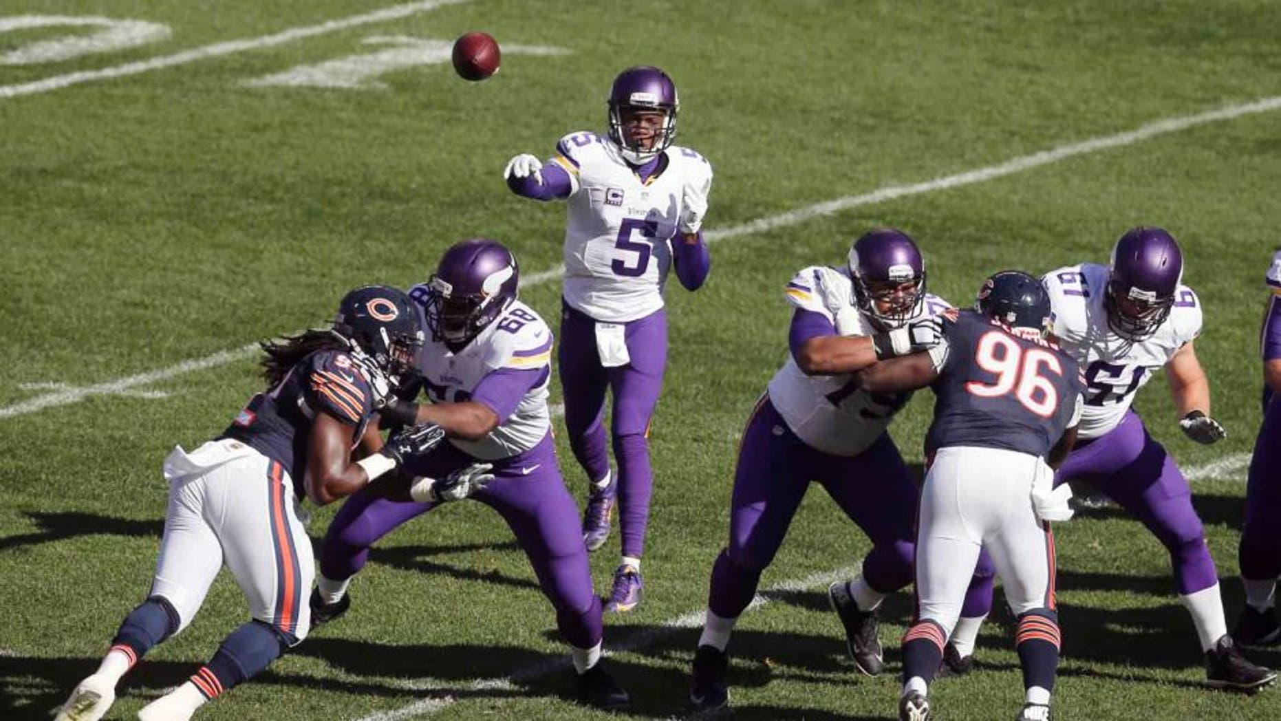 Minnesota Vikings quarterback Teddy Bridgewater throws a pass against the Chicago Bears during the first half of an NFL football game Sunday, Nov. 1, 2015, in Chicago.
